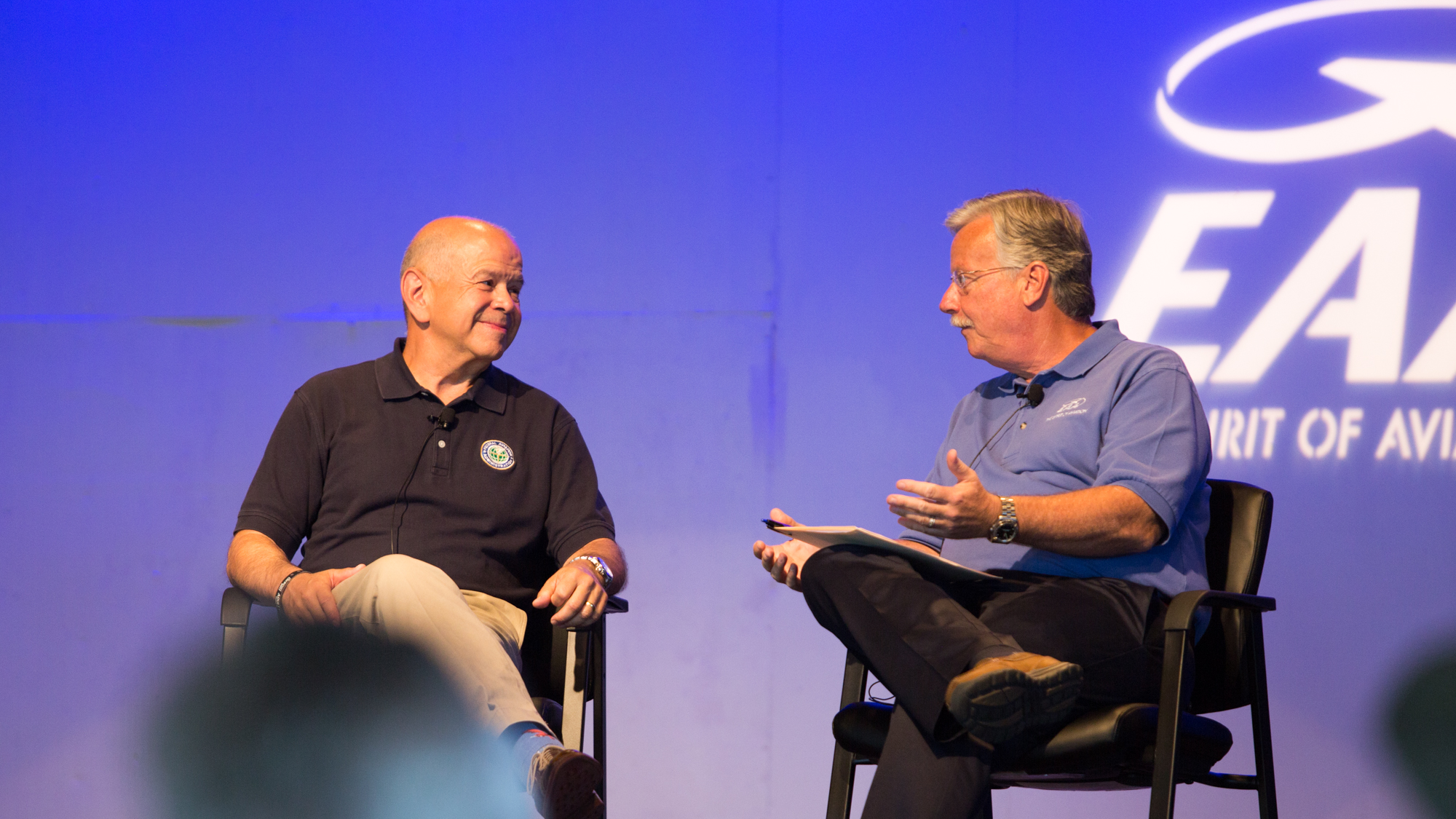FAA Administrator Michael Huerta chats with EAA CEO Jack Pelton at EAA AirVenture July 27. Jim Moore photo.