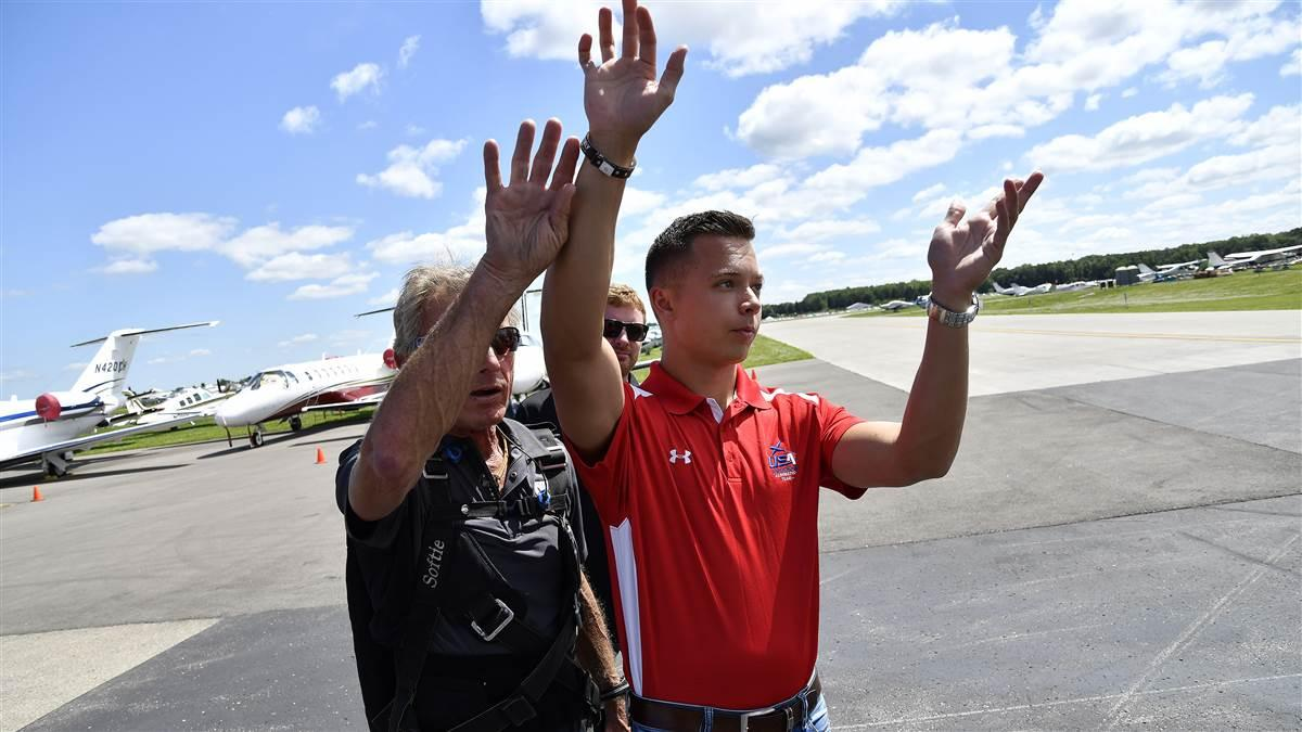 Cameron Jaxheimer, 22, visualizes maneuvers on the ramp with Team Oracle aerobatic performer and mentor Sean D. Tucker during EAA AirVenture. Photo by David Tulis.