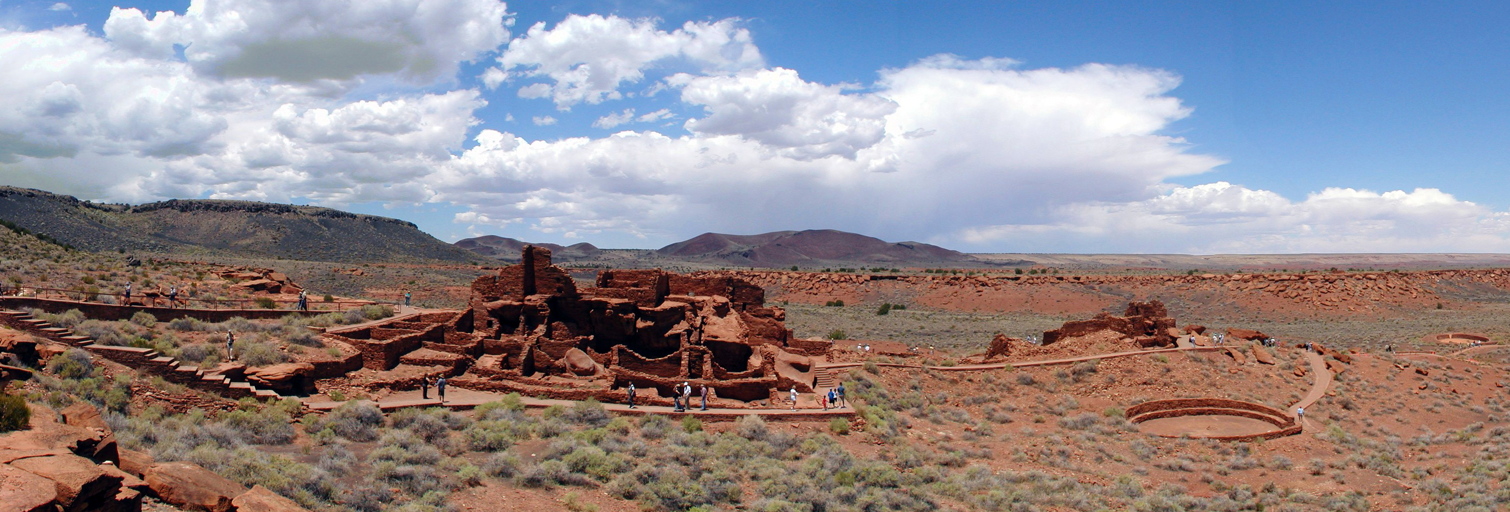 Panoramic view of the pueblo dwelling and other structures at Wupatki National Monument. Photo by Stephen McCluskey via Wikipedia.