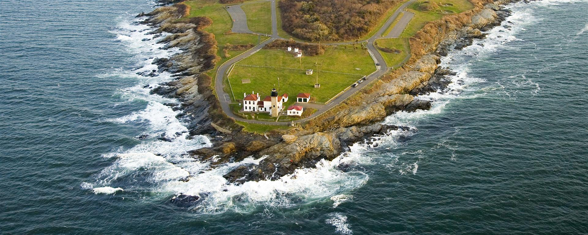 See the Beavertail Lighthouse and Gilded Age homes on an aerial tour of Newport. Photo courtesy Bird's Eye View Helicopters.