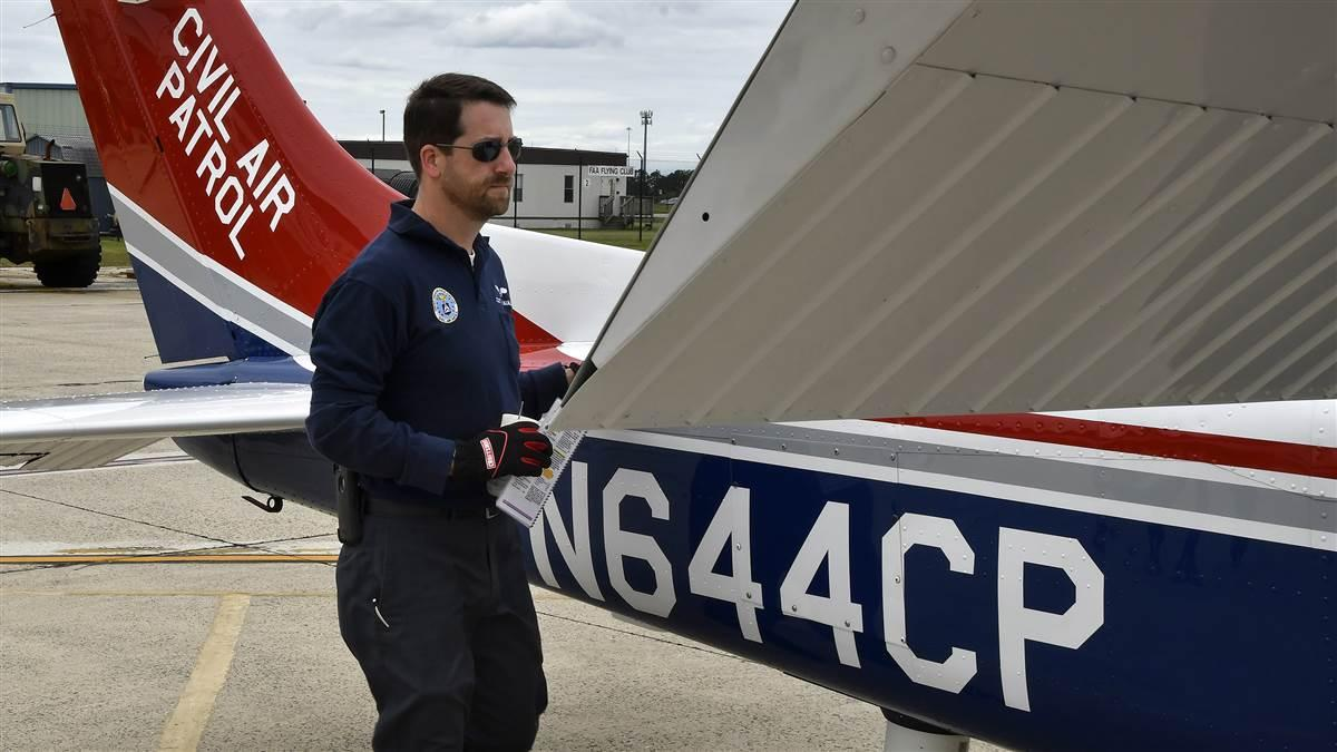Civil Air Patrol volunteer pilot Scott Faulkner preflights a Cessna 182 before a joint mission by NORAD, the Civil Air Patrol, and the Coast Guard from the 177th Fighter Wing in Egg Harbor Township, New Jersey. Photo by David Tulis.