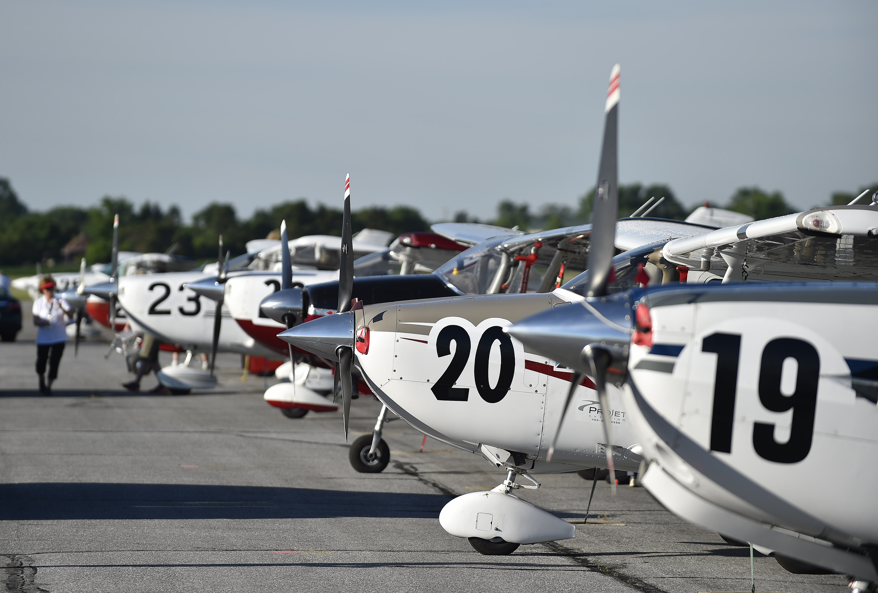 Air Race Classic aircraft are lined up and ready to start the 2017 race from Frederick, Maryland. In 2018, the teams will start in Texas and wind their way through the United States to end in Maine. Photo by David Tulis.