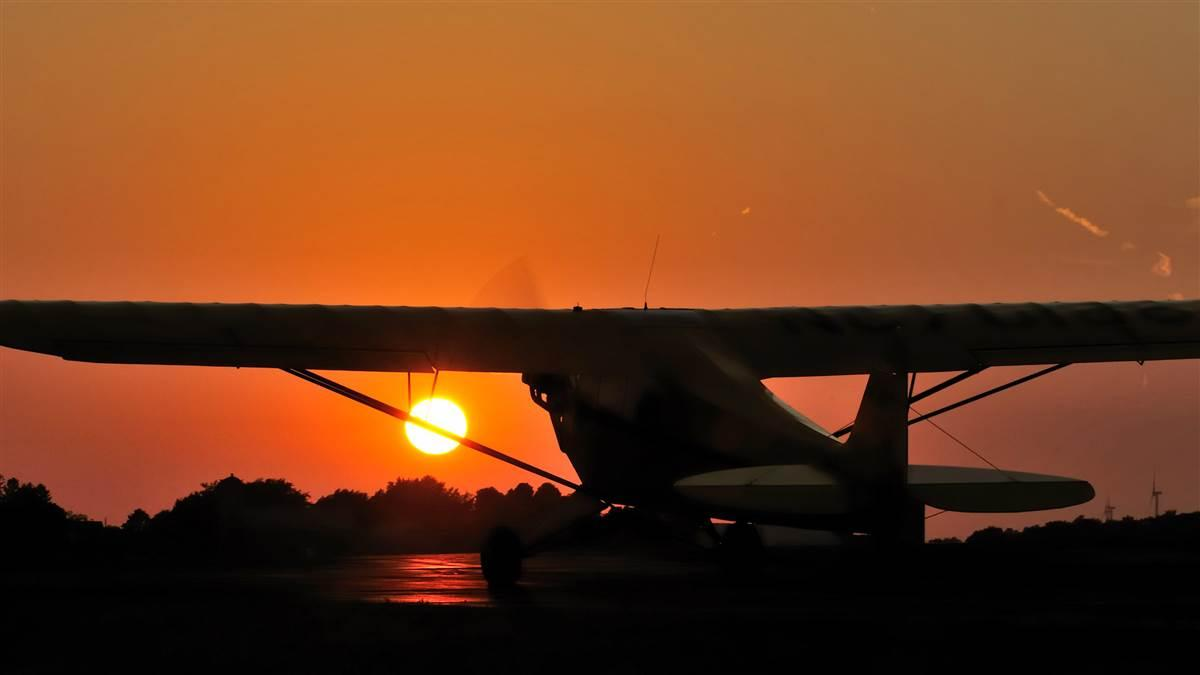 A Piper Cub taxis at sunset in Hartford, Wisconsin, the evening before the July 22, 2012, Cubs2Oshkosh flight commemorating the Piper J-3 Cub's 75th anniversary. Photo by Mike Collins.