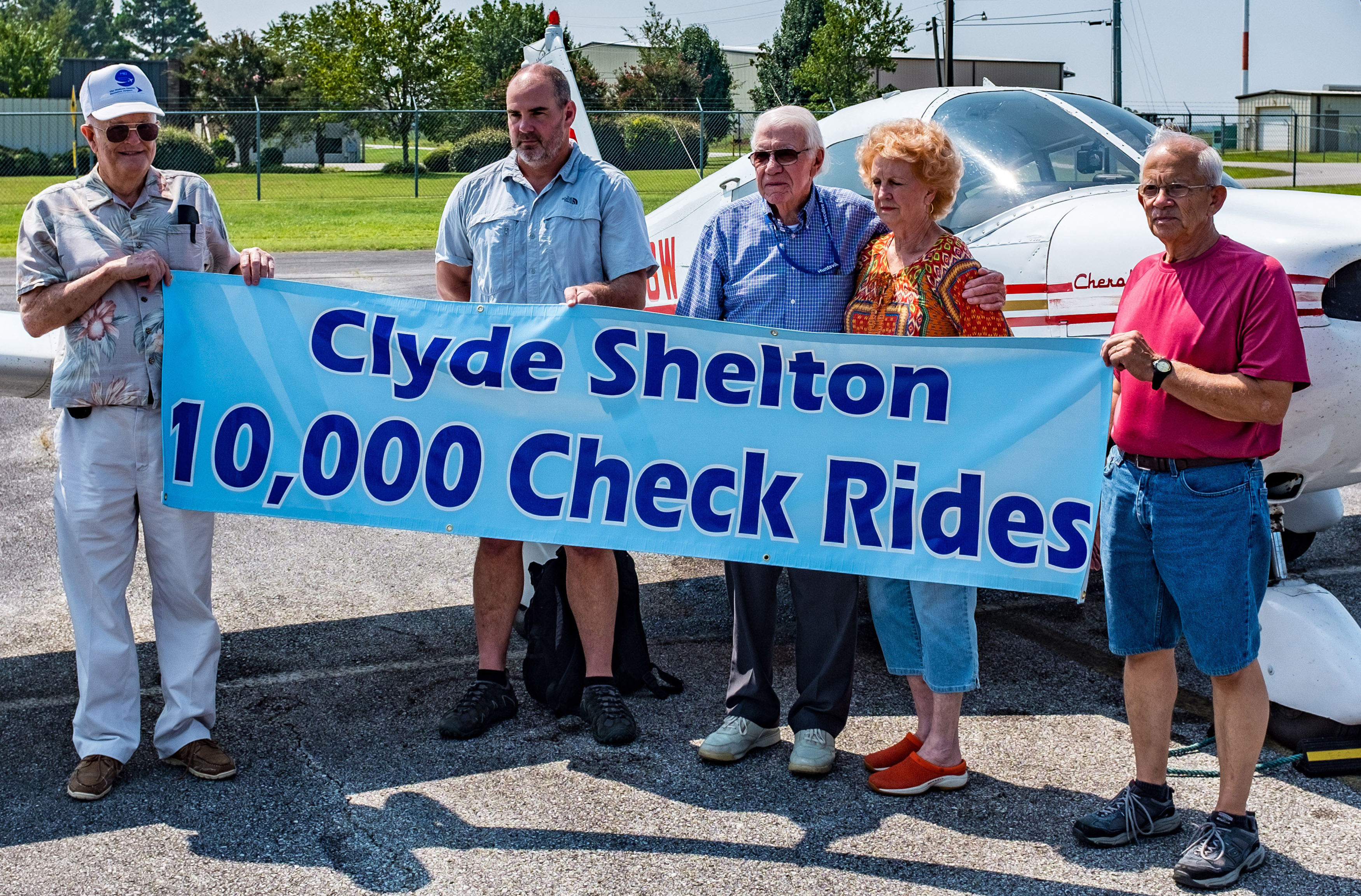 Clyde Shelton celebrates administering his 10,000th flight exam. Photo courtesy of Marty Sellers/sellersphoto.com.