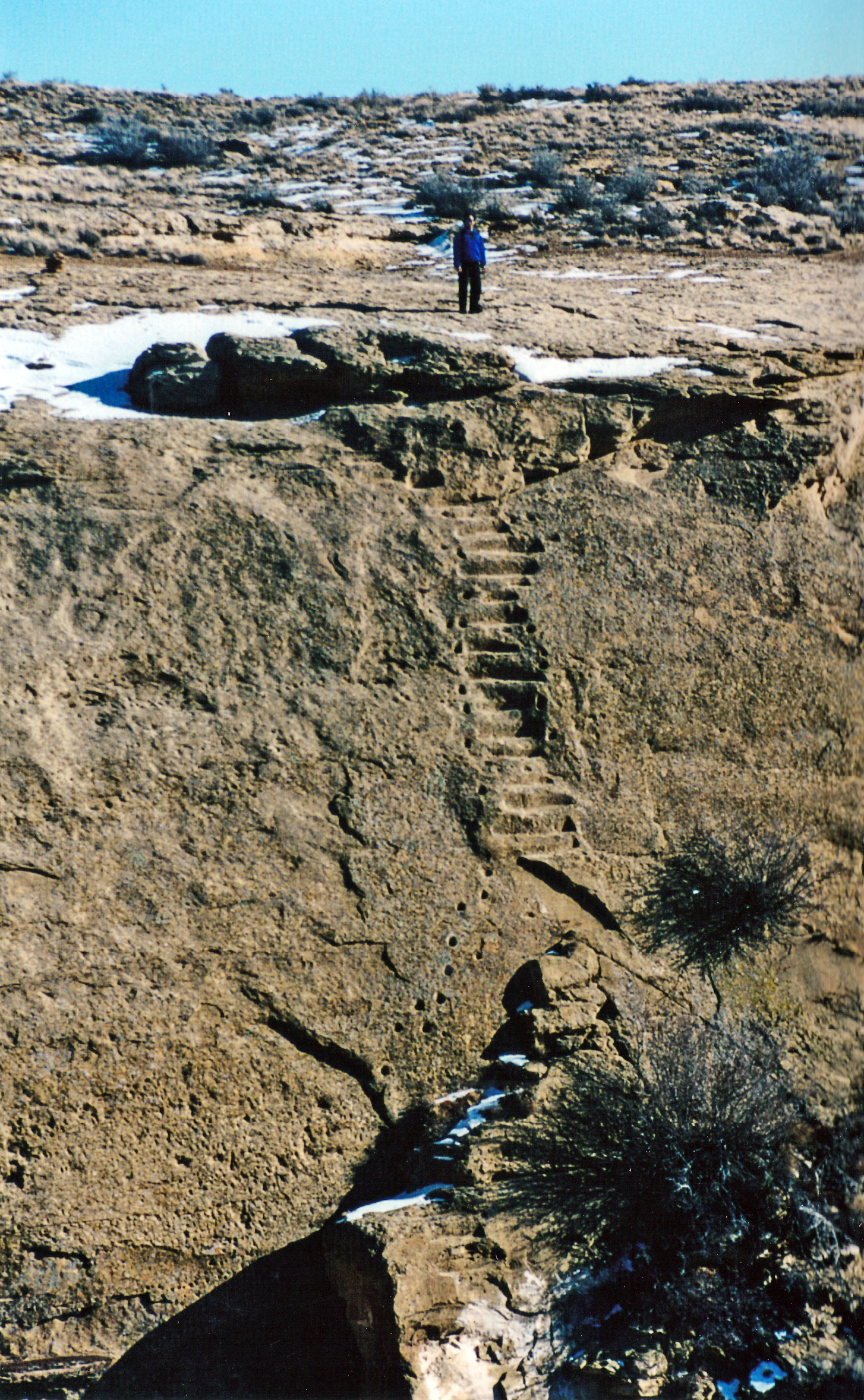 The prehistoric stairway and handholds were carved into this cliff by the Chacoan people who made this area the center of a vast trading zone radiating hundreds of miles in all directions from what is now Chaco Culture National Historical Park. Photo by Crista Worthy.