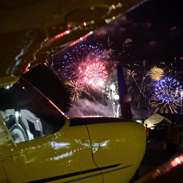 Fireworks explode over a Cessna 172. Photo by David Tulis.