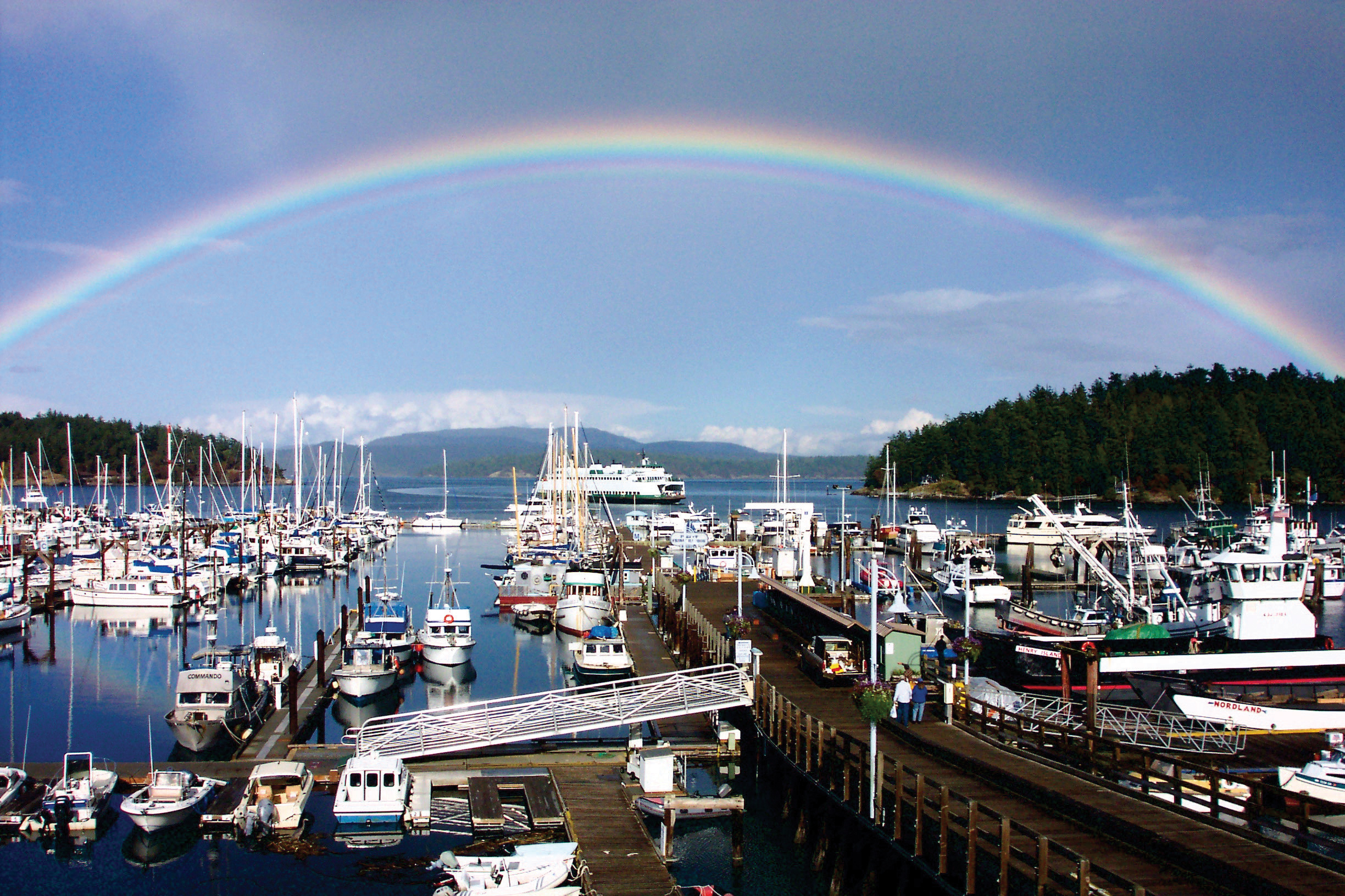 A rainbow arcs over Friday Harbor, on San Juan Island. Walk here from the airport to shop, dine, or board a whale watching tour. Photo courtesy San Juan Islands Visitors Bureau.