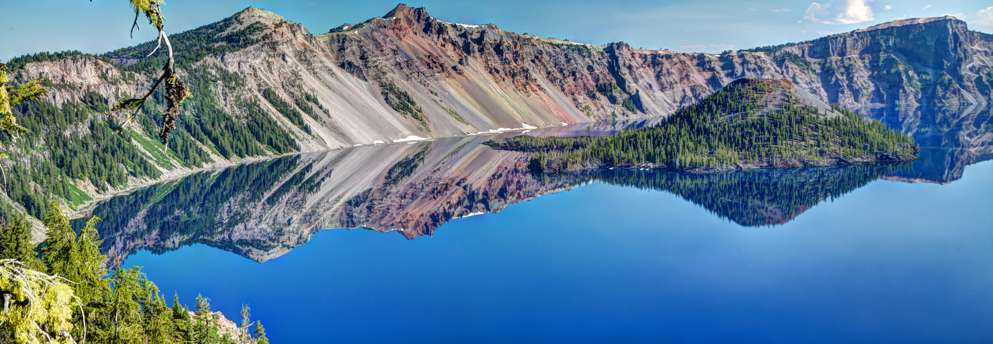 On a clear, still day Crater Lake's deep blue reflective water is mesmerizing. Photo by Scott Smithson via Flickr.