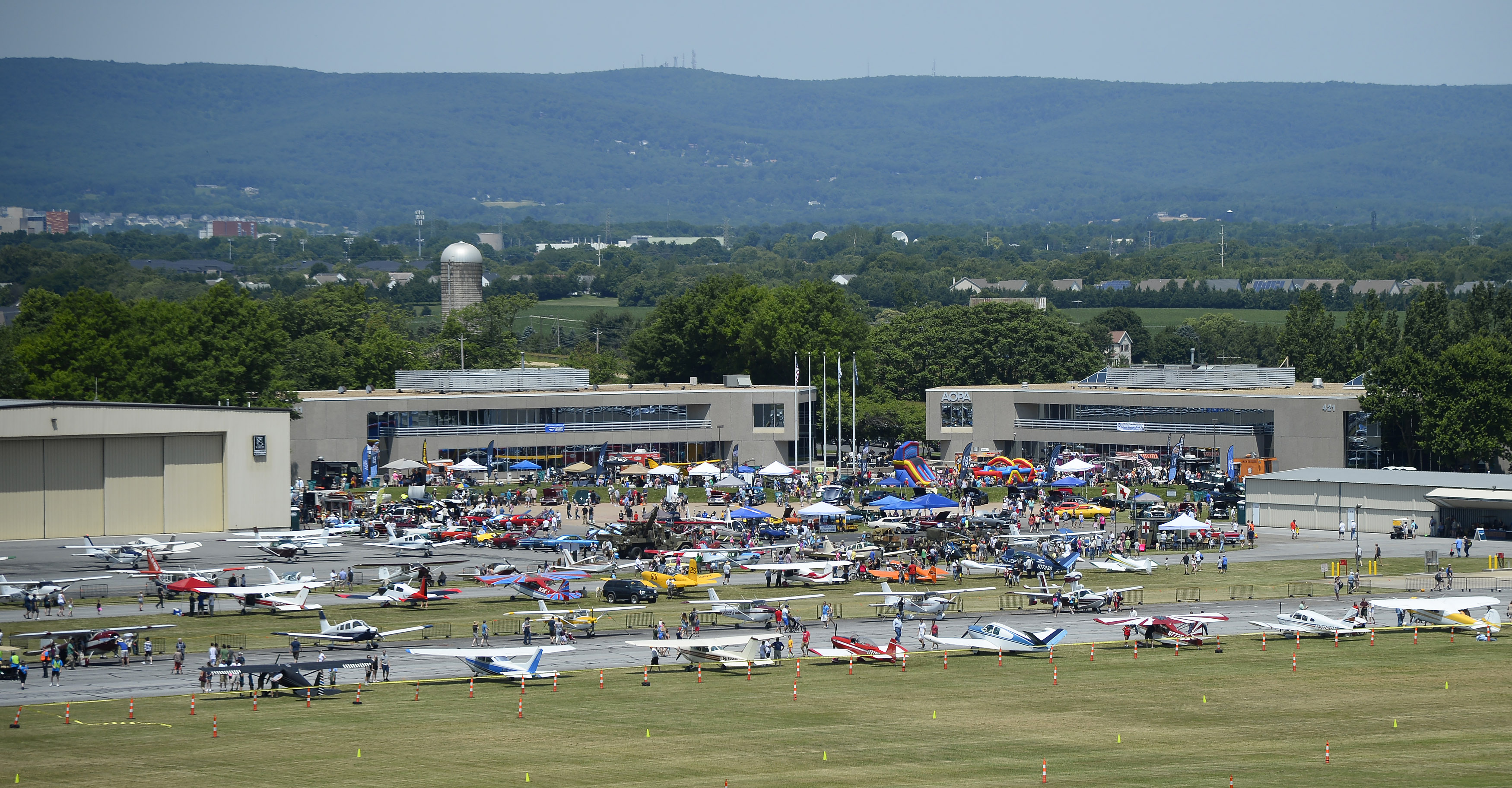 Aviation, automobile, and motorcycle aficionados attend the Wings 'n Wheels event near AOPA headquarters in Frederick, Maryland. Photo by David Tulis.