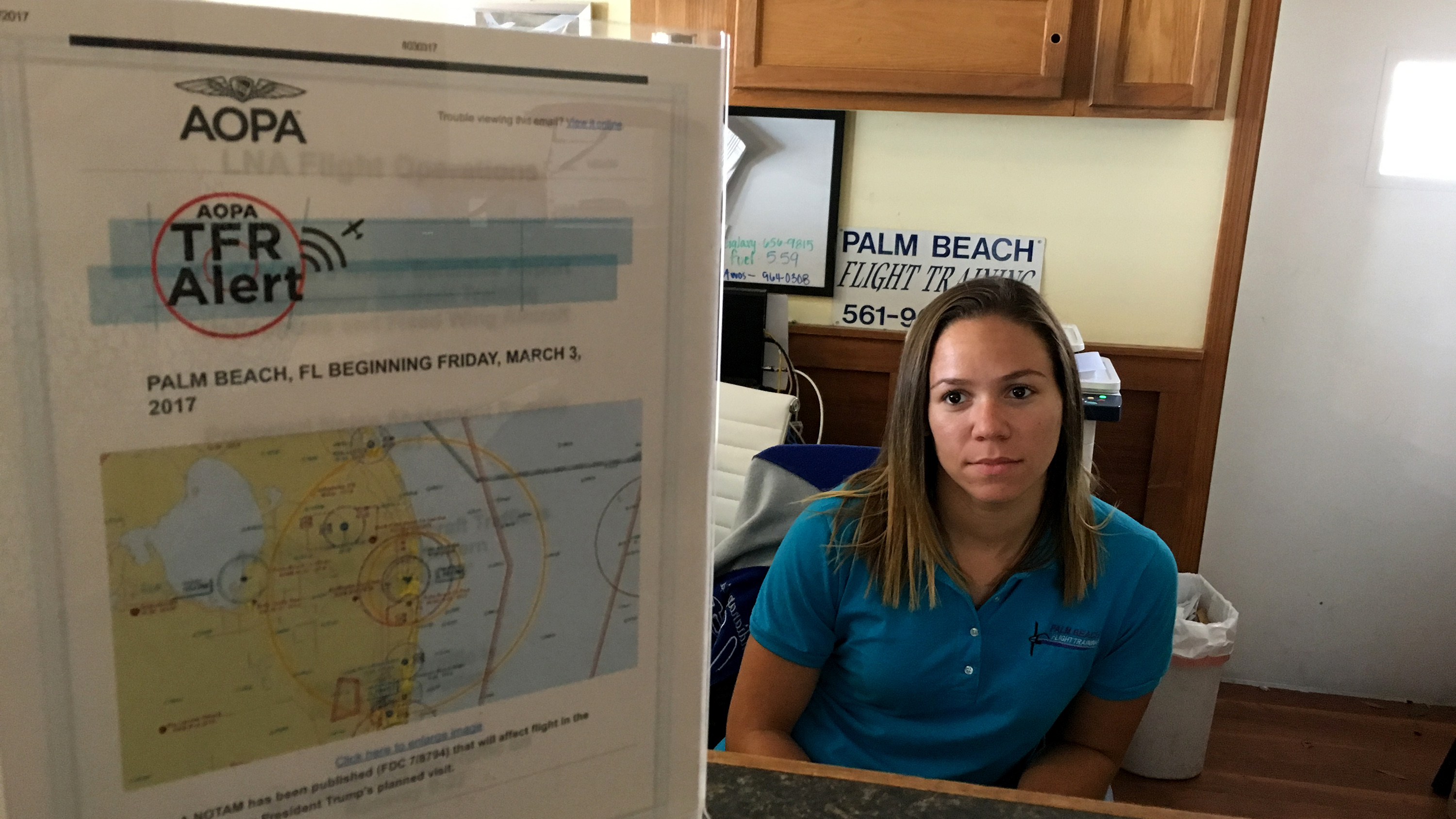 Palm Beach Flight Training Office Manager Michelle Edwards endures slow days at the flight school when presidential TFRs shut down Lantana Airport. Photo courtesy of Palm Beach Flight Training.