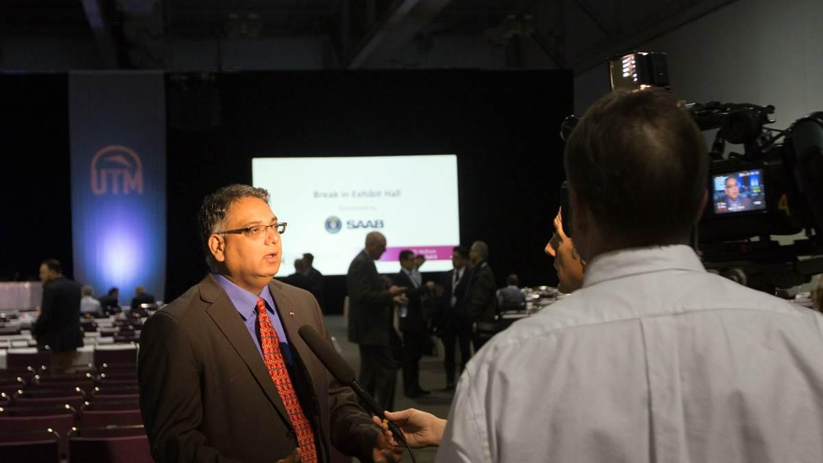 NASA UAS Traffic Management Program Principal Investigator Parimal Kopardekar is interviewed by local media at the UTM Convention in Syracuse, New York, in 2016. AOPA file photo.