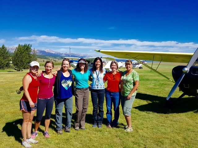 Christina Tindle (center, in blue shirt) will host a weekend of backcountry flying designed for women in Idaho in July. This photo is from the 2016 WomenWise Airmanship Adventure in Smiley Creek, Idaho.