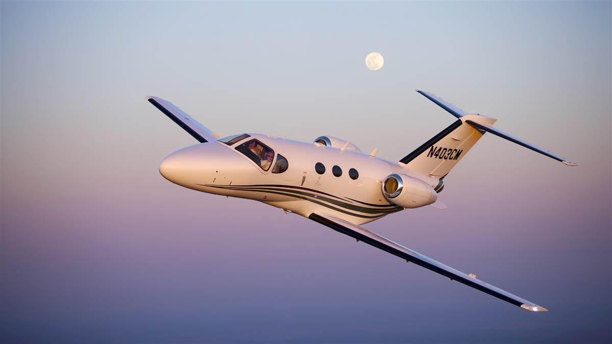 AOPA Senior Photographer Mike Fizer photographs the Cessna Mustang southwest of Wichita with a full moon.