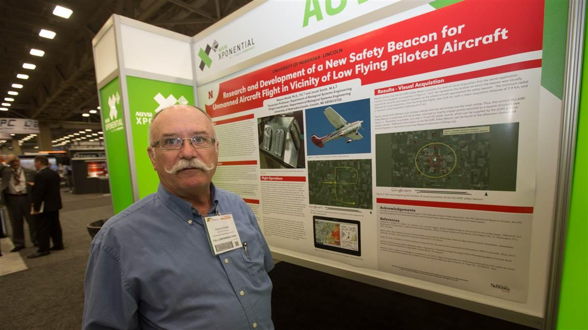 Associate Professor Wayne Woldt of the University of Nebraska, Lincoln, came to AUVSI Xponential hoping to attract interest in producing a strobe light system designed to warn agricultural aircraft pilots and other low-altitude manned operators of the presence of unmanned aircraft. Photo by Jim Moore.