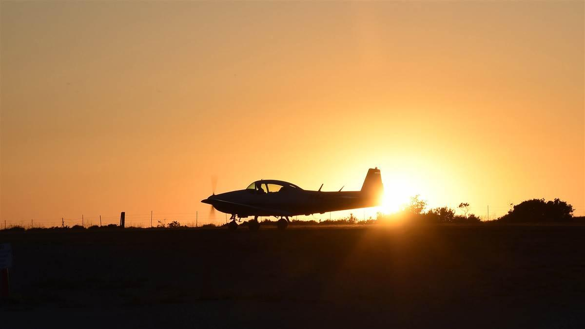 Pat Mullen taxies his 1948 Navion past the setting sun at Catalina Island's Airport in the Sky during an inaugural fly-out hosted by the Cessna Pilots Society following the AOPA Fly-In at Camarillo, California, April 29. Photo by David Tulis.