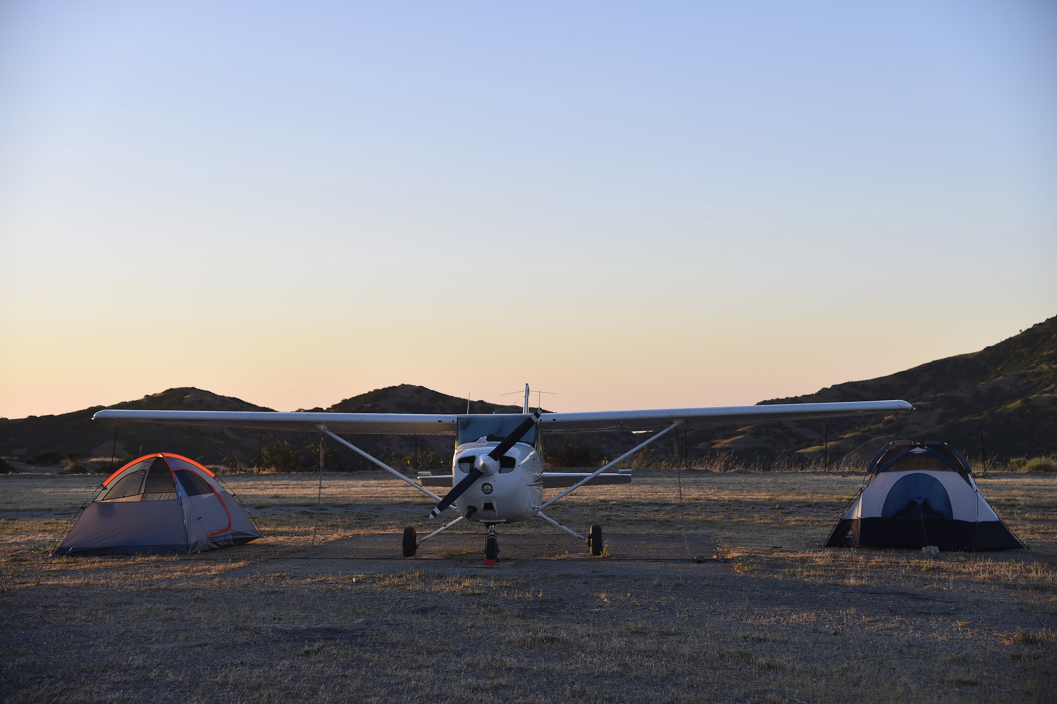 Brothers-in-law Albert Gersh and Steve Destler pitched a couple of tents next to their Cessna 172 on Catalina Island. Photo by David Tulis.