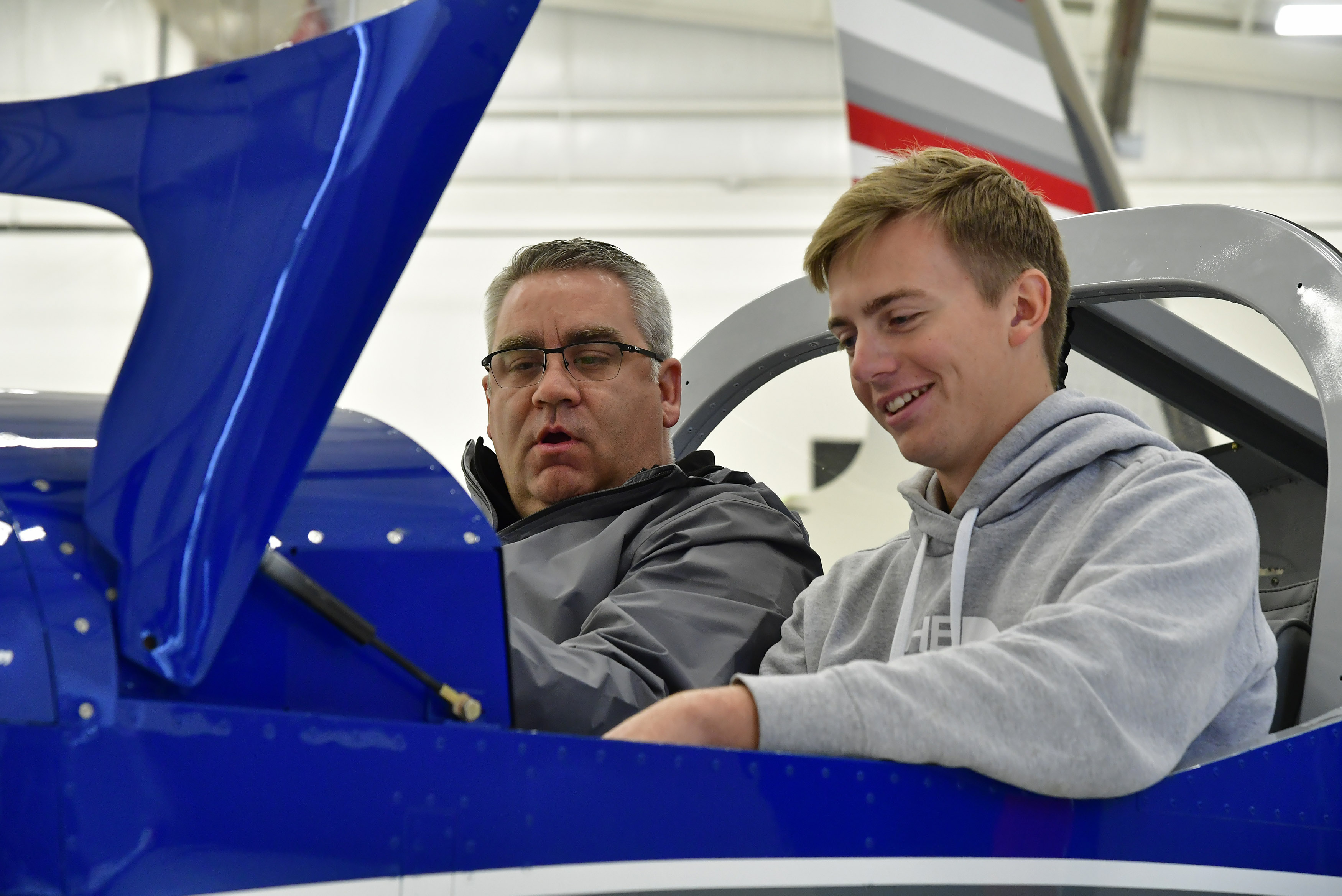 Phillip Campbell familiarizes a Van's Aircraft RV-12 cockpit with McKinney High School student Bryan Soltys-Niemann during an aviation class at McKinney National Airport in McKinney, Texas. Photo by David Tulis.
