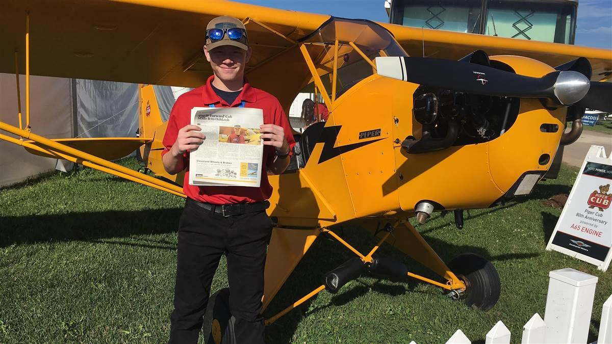 Kyle Carden near a Piper Cub donated to his family by Cub owner Paul Wenz. Photo courtesy of Continental Motors.