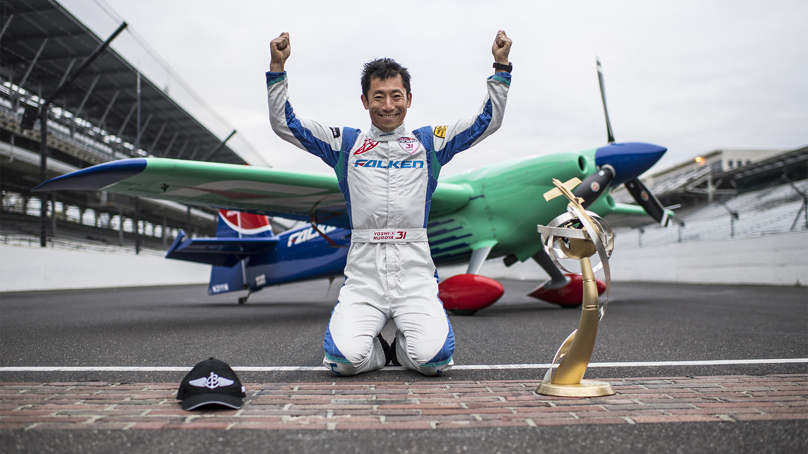 Yoshihide Muroya of Japan poses for a photograph after he won at the eighth round of the Red Bull Air Race World Championship at Indianapolis Motor Speedway. Photo by Joerg Mitter / Red Bull Content Pool.