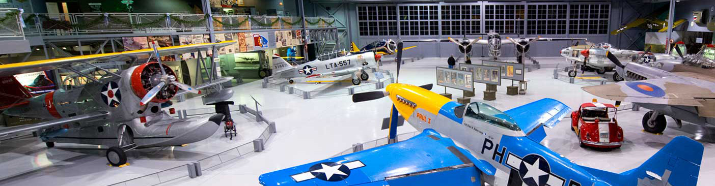 A P-51, Grumman Duck, and other warbirds fill the Eagle Hangar at the EAA Aviation Museum in Oshkosh, Wisconsin. Photo courtesy EAA.