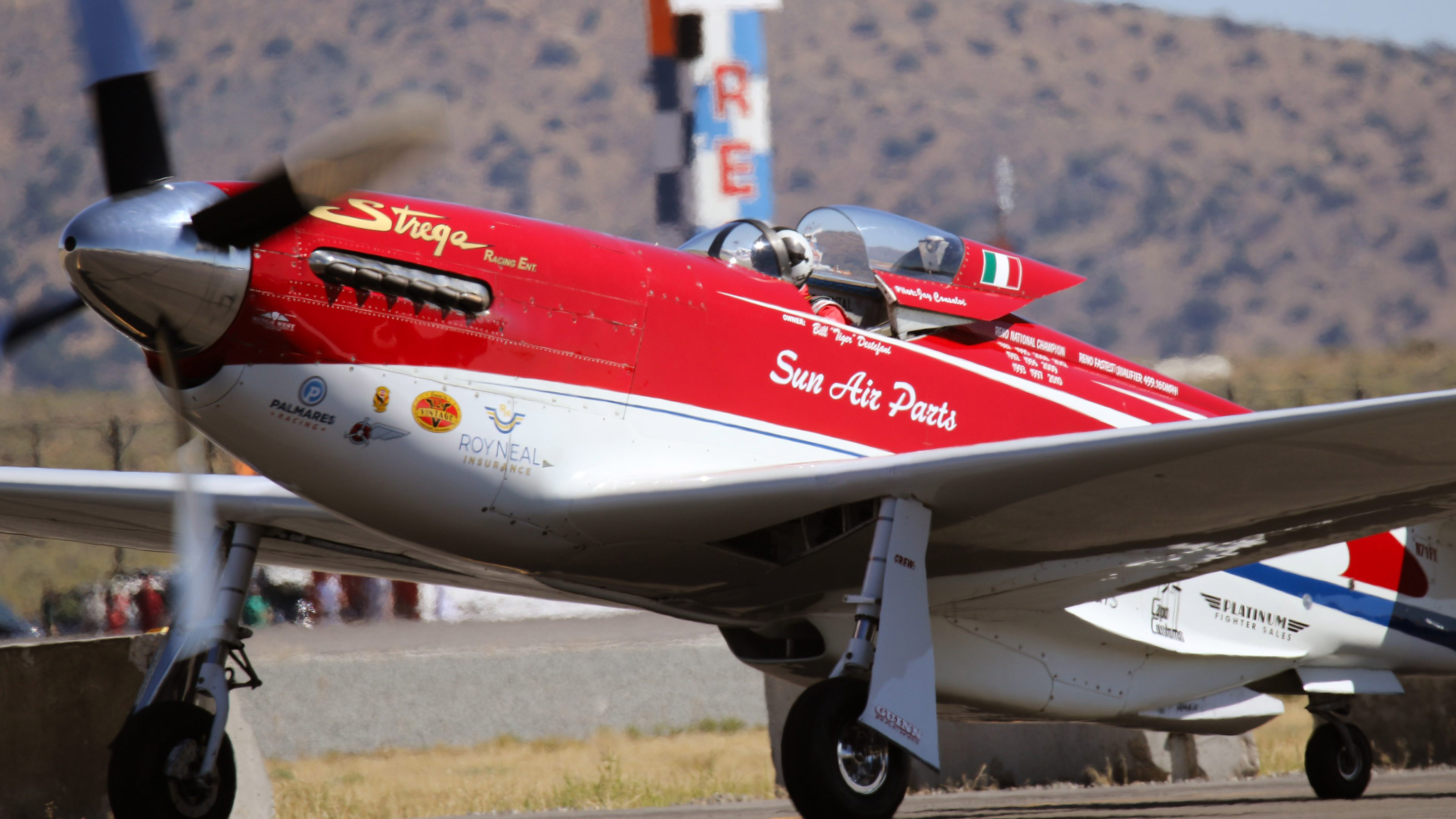 """Strega"" won the penutlimate Unlimited Gold race during the fifty-fourth National Championship Air Races in Reno, Nevada, Sept. 17. Here the P-51D taxies for a heat earlier in the week. Photo by Robert Fisher."
