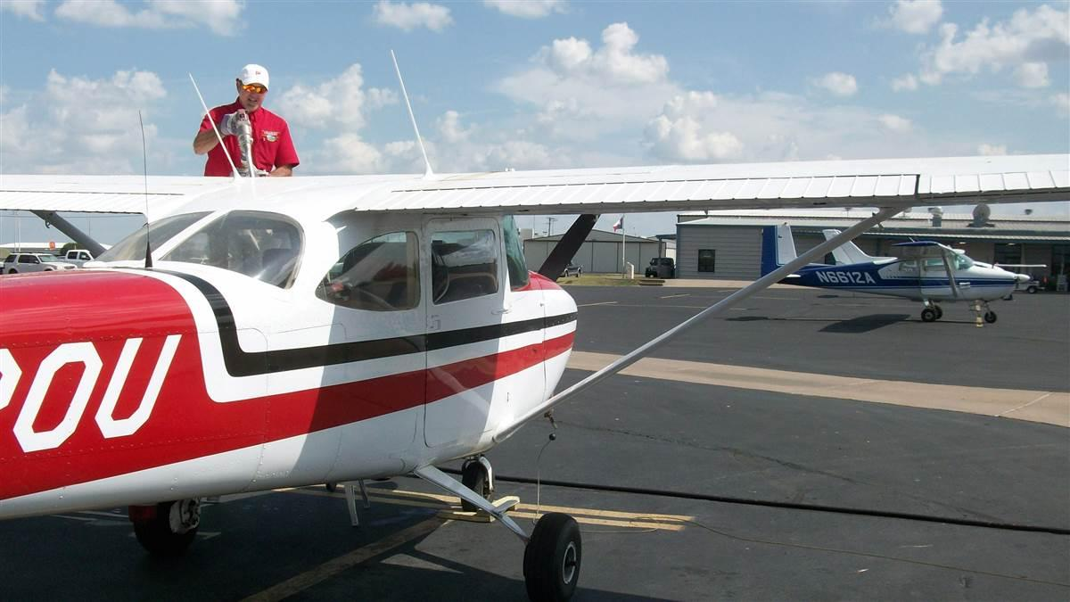 Stephen Vale refuels a locally based Cessna Skyhawk at Granbury Regional Airport. Photo courtesy of Peter D. Heffley.