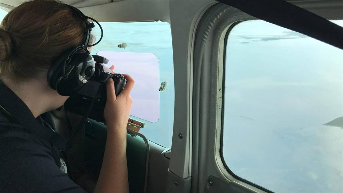 Civil Air Patrol Maj. Natalie Franc makes an aerial photo above the Brazos River in Houston, during a Hurricane Harvey assessment mission. Photo courtesy of Lt. Col. Ronald F. Diana, Civil Air Patrol.