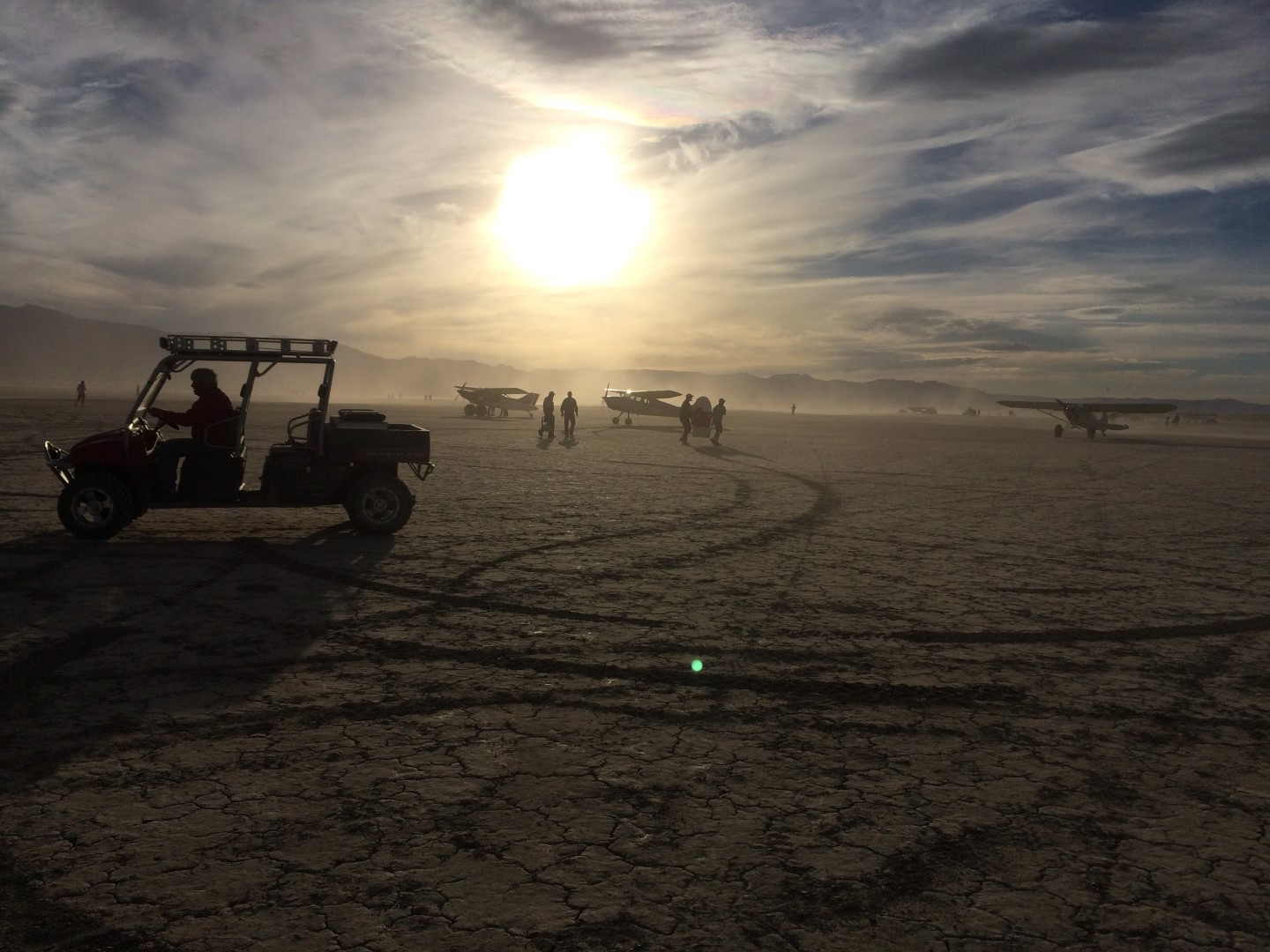 Winds or prop wash kick up playa dust, but that's part of being out in the desert. Not everyone flies in; some people drive in with RVs, pickups, or trailers that also pack golf carts or ATVs. Photo by Nadine Burak.
