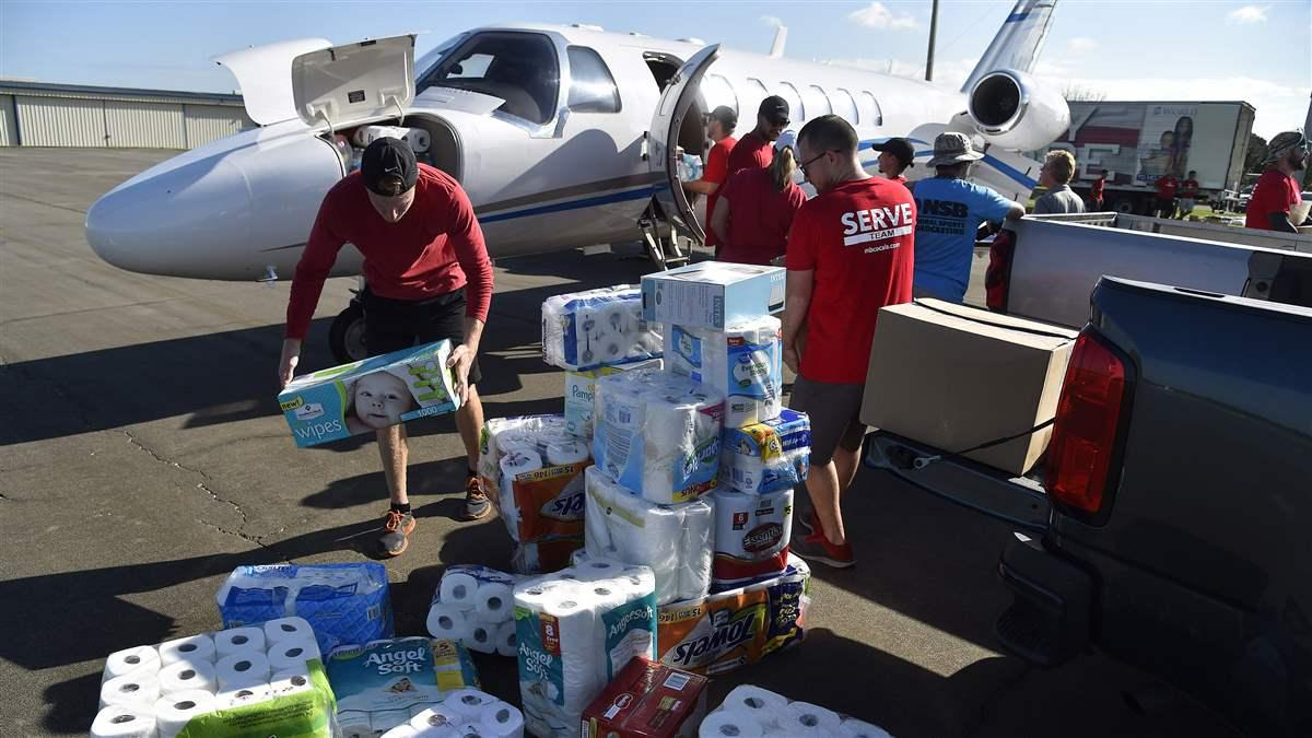 Meadowbrook Church volunteers at Ocala International-Jim Taylor Field Airport load supplies into a Cessna Citation jet bound for St. Croix, U.S. Virgin Islands, Sept. 14. Photo by David Tulis.