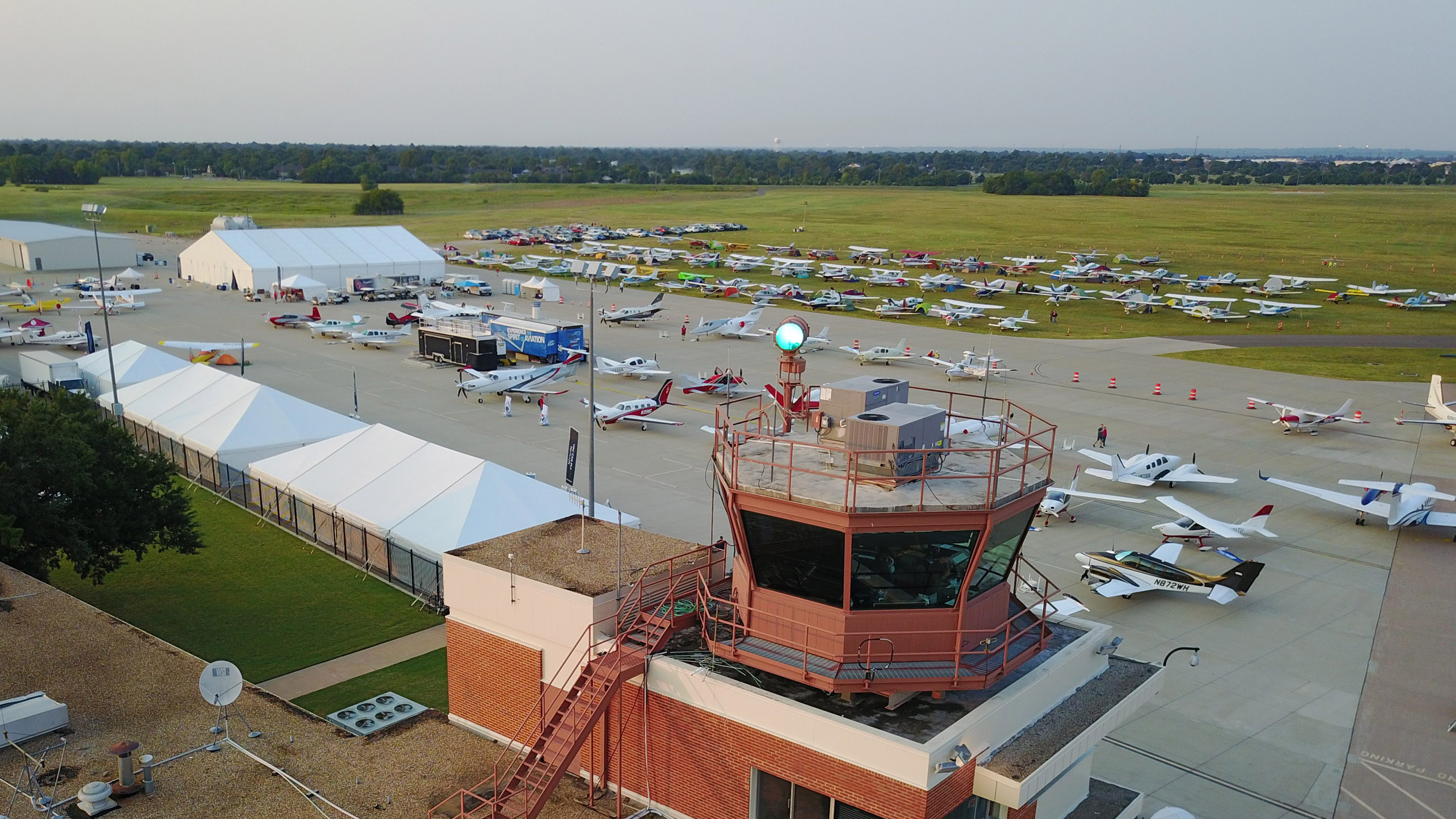 Day breaks over the University of Oklahoma Westheimer Airport in Norman on Saturday, Sept. 9, welcoming AOPA's 2017 Norman Fly-In. Photo by Walt Strong.
