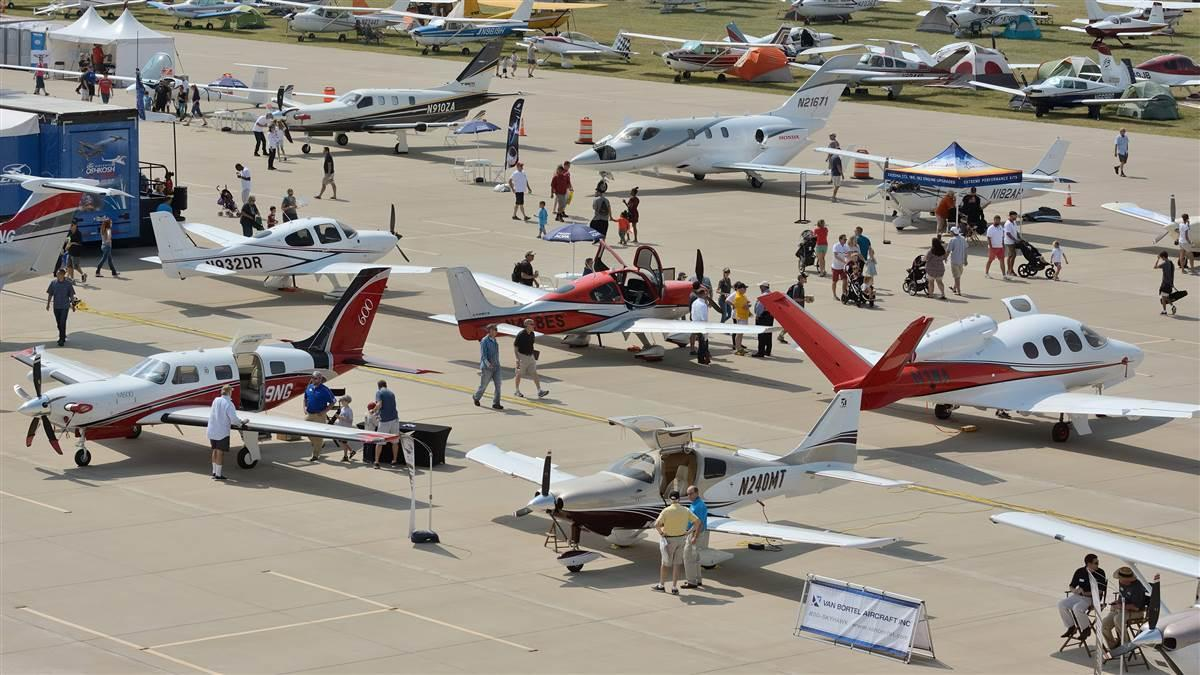 Visitors to AOPA's 2017 Norman Fly-In inspect some of the many display aircraft on hand for the event. Photo by Mike Collins.