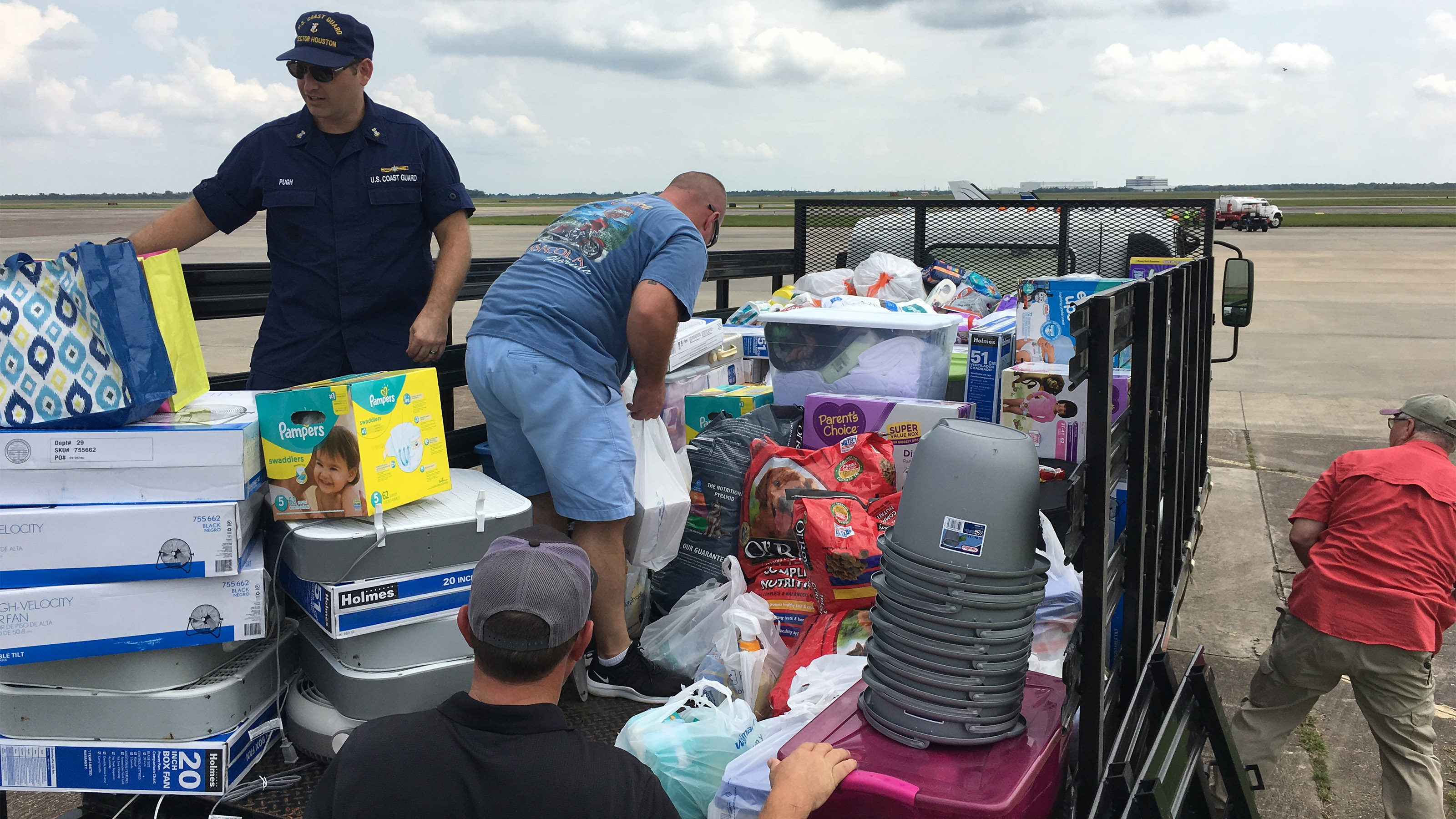 Distributing supplies at Ellington Airport (KEFD) to directly support U.S. Coast Guard families displaced by Hurricane Harvey.  Photo courtesy of Robert Johnson.