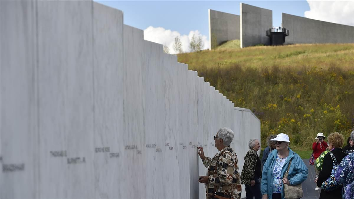 People visit the Wall of Names at the Flight 93 National Memorial near Shanksville, Pennsylvania, which honors the 40 passengers and crew aboard a United Airlines jetliner that was hijacked by terrorists Sept. 11, 2001. Photo by David Tulis.