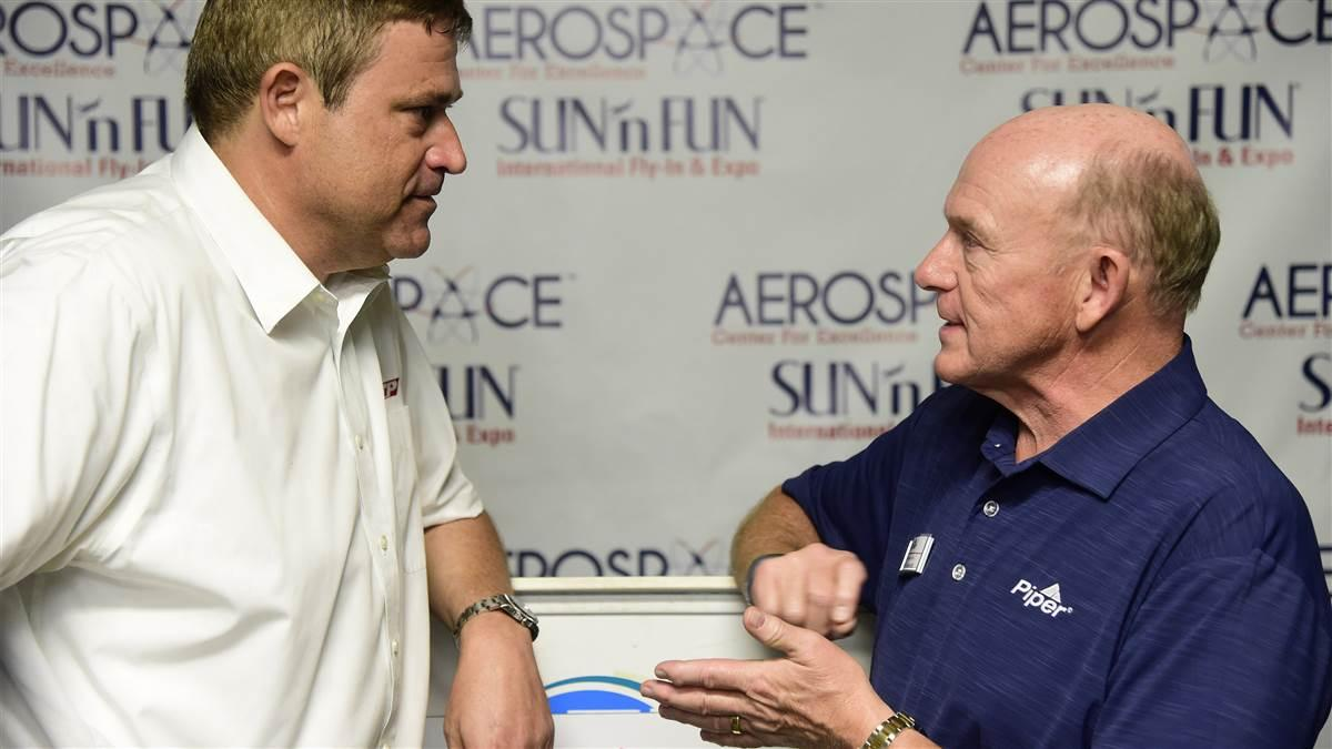 Piper Aircraft CEO Simon Caldecott and ATP Director of Admissions Eric Priester announce a deal for 100 Piper Archer TX aircraft during the Sun n Fun International Fly-In and Expo in Lakeland, Florida, Tuesday, April 10, 2018. Photo by David Tulis.