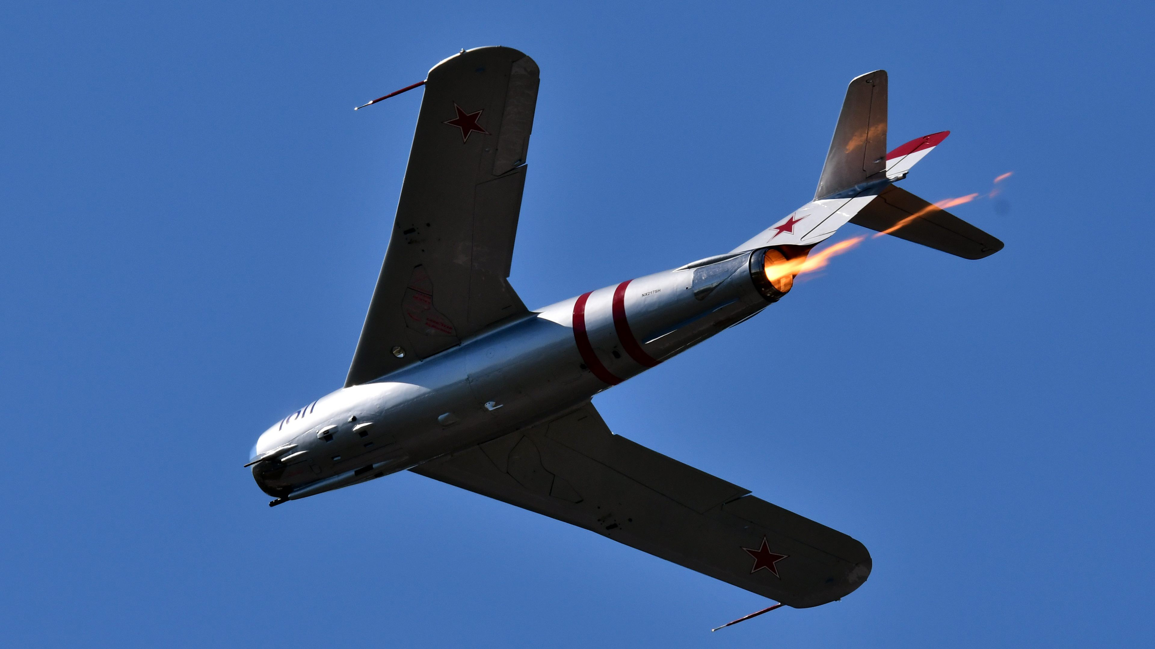 Flames from the afterburner trail behind Randy Ball's MiG-17F during a performance at Sun 'n Fun. Photo by Mike Collins.