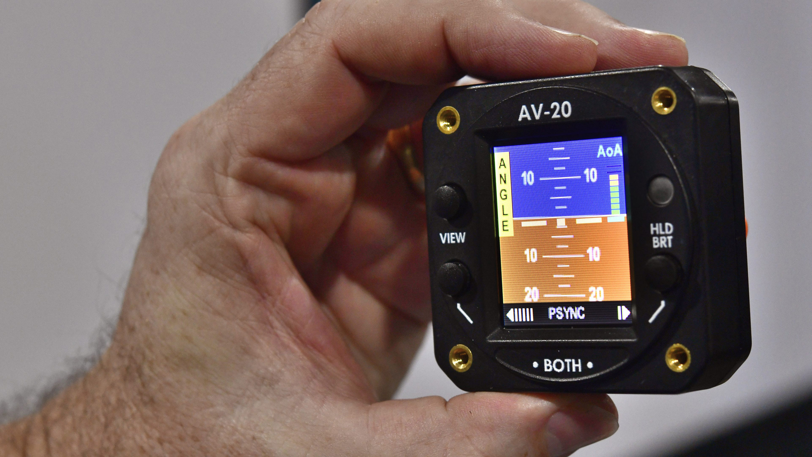 FAA NORSEE certification is pending for AeroVonics' AV-20-S, a two-inch-diameter, self-contained multifunction display with integral angle of attack and other capabilities. The company displayed it at EAA AirVenture 2018. Photo by Mike Collins.