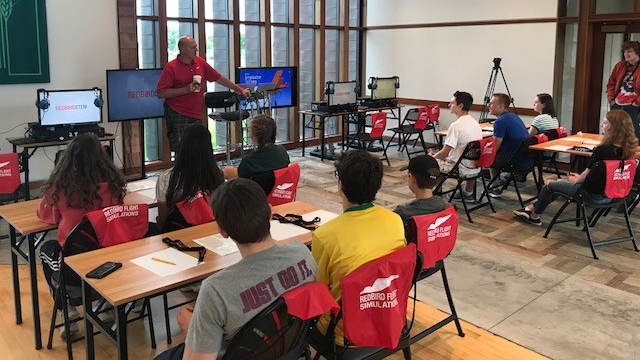 The GAMA 2018 Aviation Design Challenge second-place team from St. Croix Lutheran Academy participates in the Redbird Flight Simulations Science, Technology, Engineering, and Mathematics (STEM) Lab Camp. Photo courtesy of GAMA.
