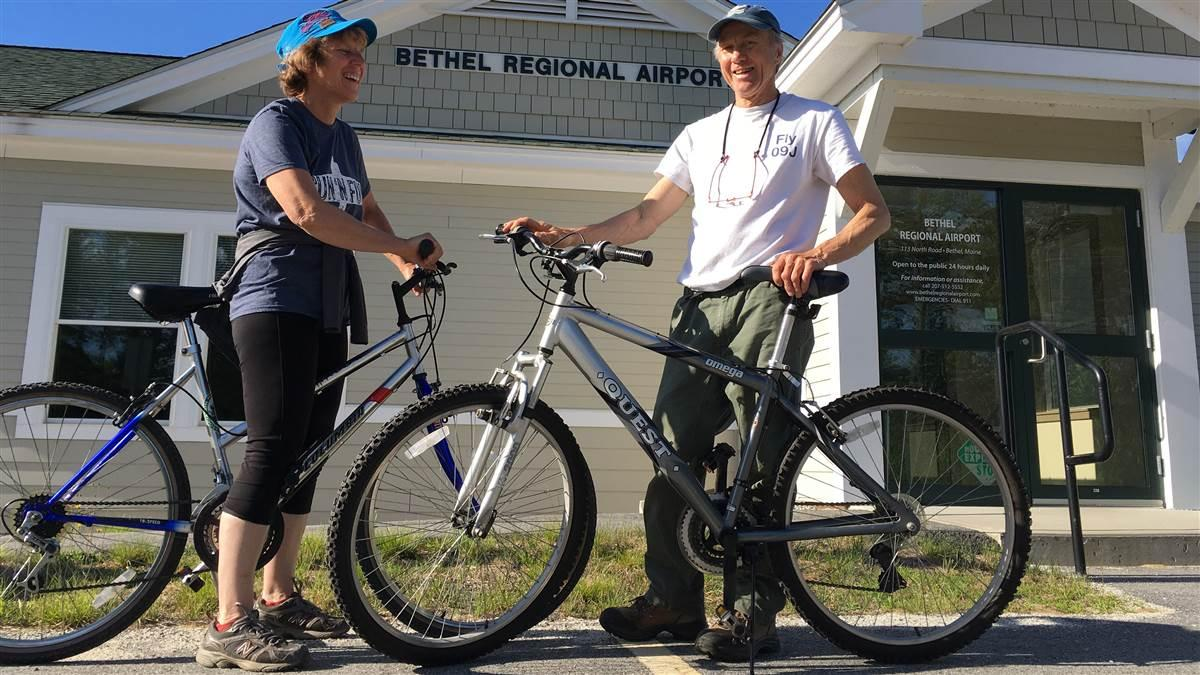 Maine Aeronautics Association President Lisa Reece and her husband Steve Williams bike at Maine's Bethel Regional Airport, one of the airports where bicycles have been made available to pilots. Photo courtesy of Lisa Reece.