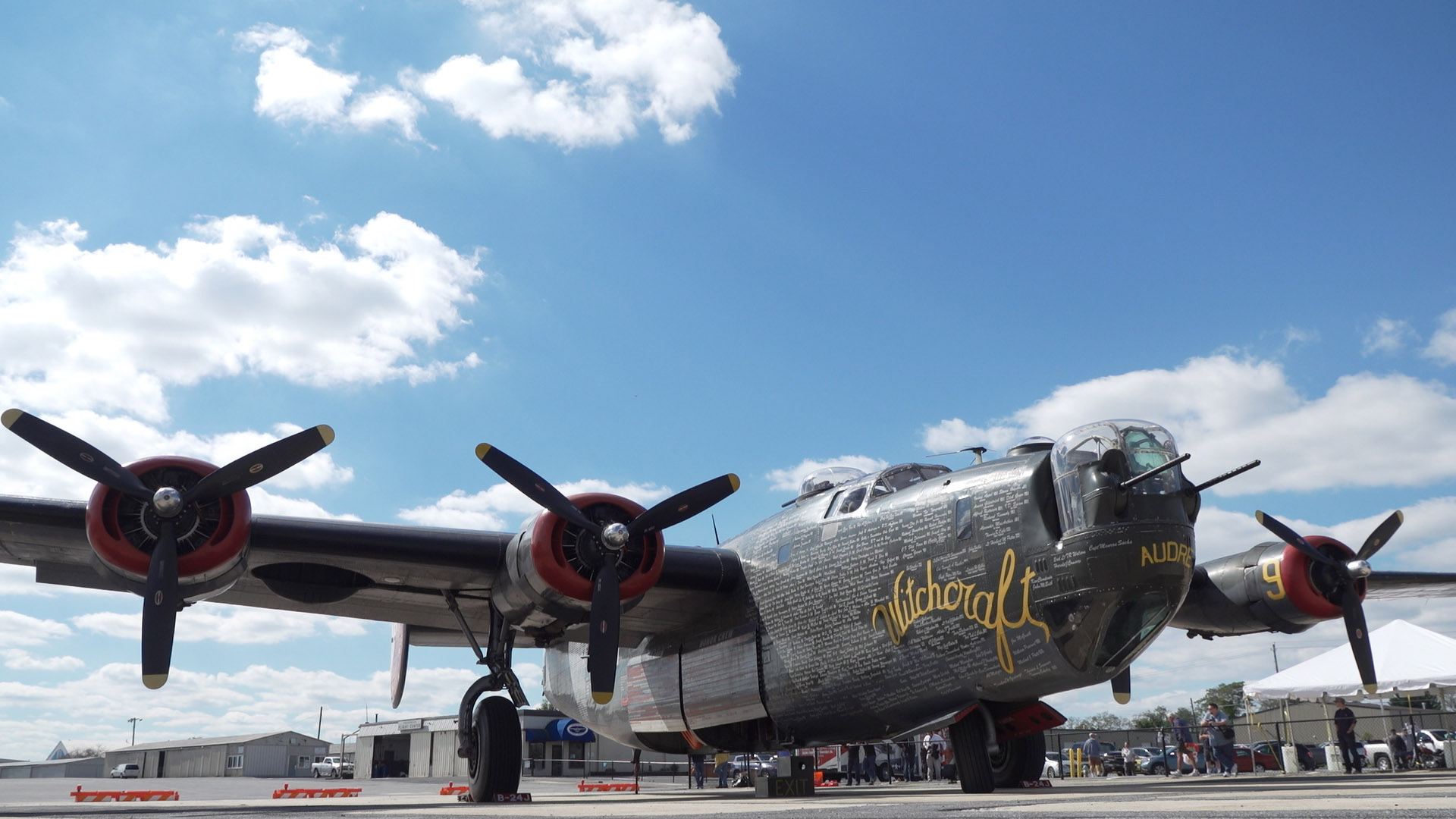 "The Collings Foundation's B-24 Liberator, ""Witchcraft,"" is parked on the ramp at Maryland's Frederick Municipal Airport during a stop on the foundation's Wings of Freedom tour. Photo by Josh Cochran."