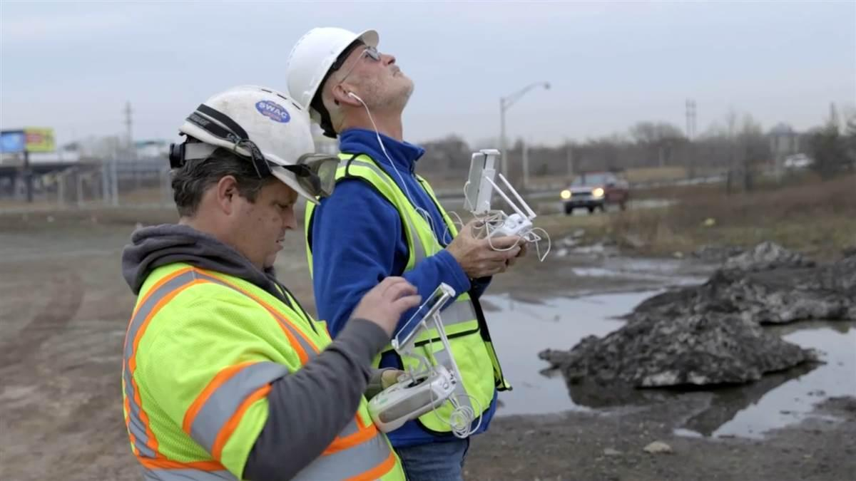 Engineer Bill Mitchell, left, operated the camera while George Finlay focused on flying during the high mast light pole inspections along New Jersey highways. Photo courtesy of George Finlay/Principia.