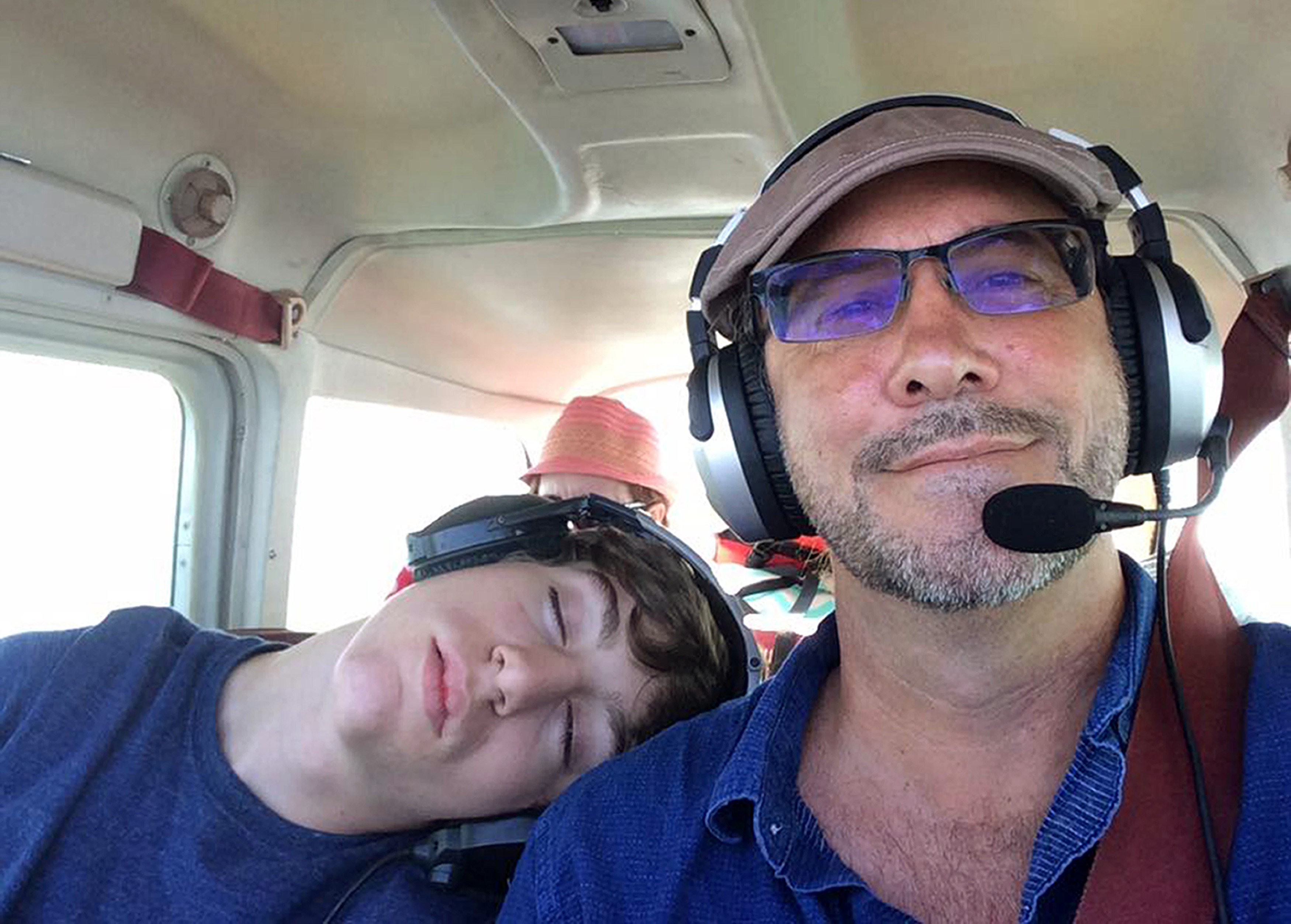 Ardis Sikes, now 17, sleeps on pilot Gerald Herbert's shoulder during a family trip in a Cessna 172. Photo courtesy of Gerald Herbert.