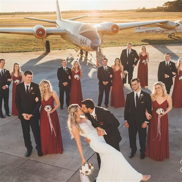Aviators and Embry-Riddle Aeronautical University graduates Mindy and Kevin Lindheim chose the Valiant Air Command Warbird Museum in Titusville, Florida, as a spectacular backdrop for their wedding. Photo courtesy of Mindy Lindheim and BowTie Photo.