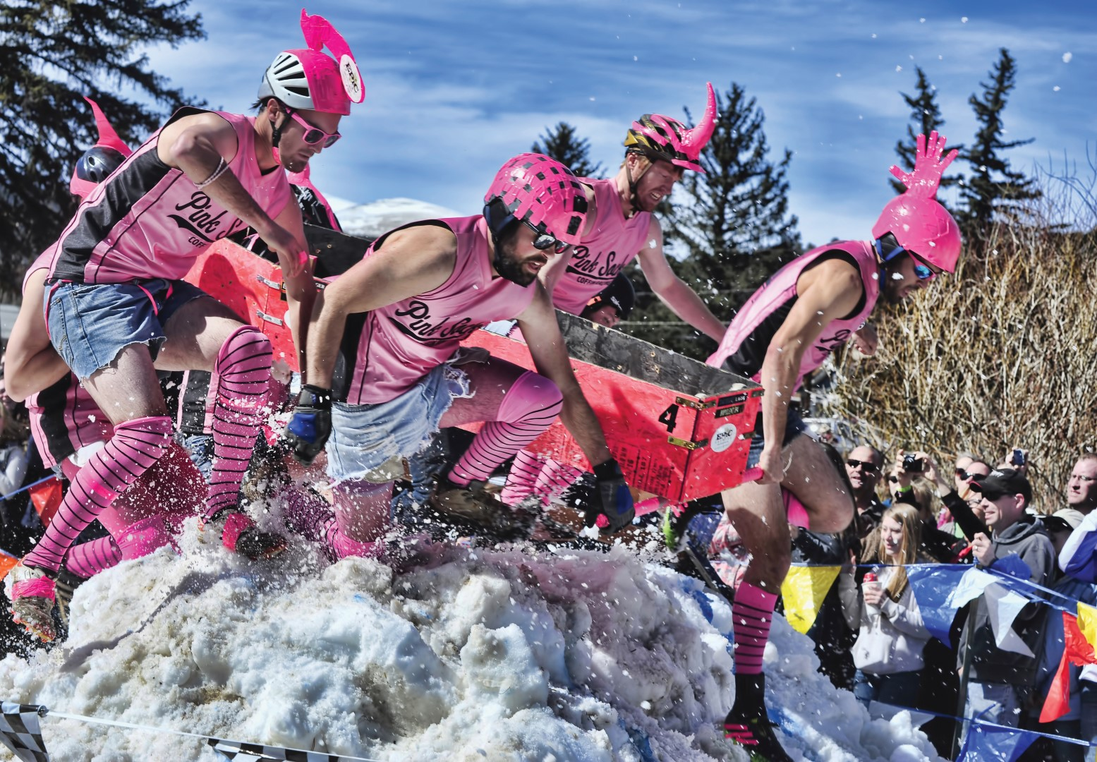 "Held in Nederland, Colorado, each year since 2002, Frozen Dead Guy Days celebrates Grandpa Bredo, whose body lies frozen on dry ice in a Tuff Shed above town. Among the many events are the Coffin Races. Teams in costume race with a coffin and 'corpse' in tow through a course full of obstacles, mud, snow, and other racers. What began as a local's event has blossomed into a shindig that in 2016 attracted an estimated 22,000 revelers. Readers Digest called it one of the ""Top Five Winter Festivals in the Country,"" while readers of USA Today proclaimed it one of the ""Top 10 Best Cultural Festivals."" Heck, it's even been written up in the New York Times. Photo by Dave Meas, courtesy Amanda MacDonald."