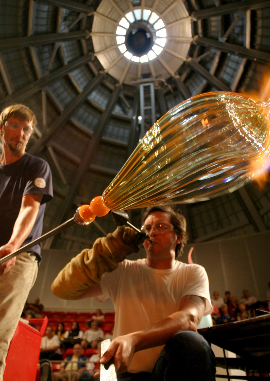 Feel the heat as you watch a team of artists create masterpieces from molten glass in the West Coast's largest Hot Shop—housed inside the iconic 90-foot stainless steel cone at the Museum of Glass. Photo by Mac Donnell.