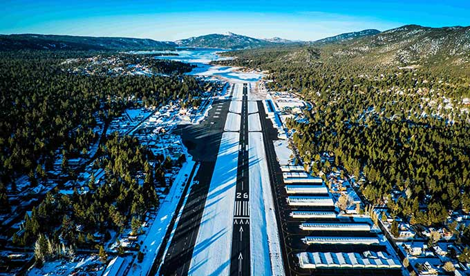 Big Bear City Airport is just a short flight from the balmy Los Angeles Basin, but you'll be climbing most of the way and arrive in an alpine environment; check density altitude on hot summer days. All traffic patterns are flown to the south of Runway 8/26. Watch for jets parked perpendicular to the runway; a Falcon jet with engines running nearly blew us off the runway just after touchdown a few years ago. The office is in the main terminal and offers competitive prices for 100LL and Jet-A. The terminal also houses the Barnstorm Restaurant. Photo courtesy Big Bear City Airport.