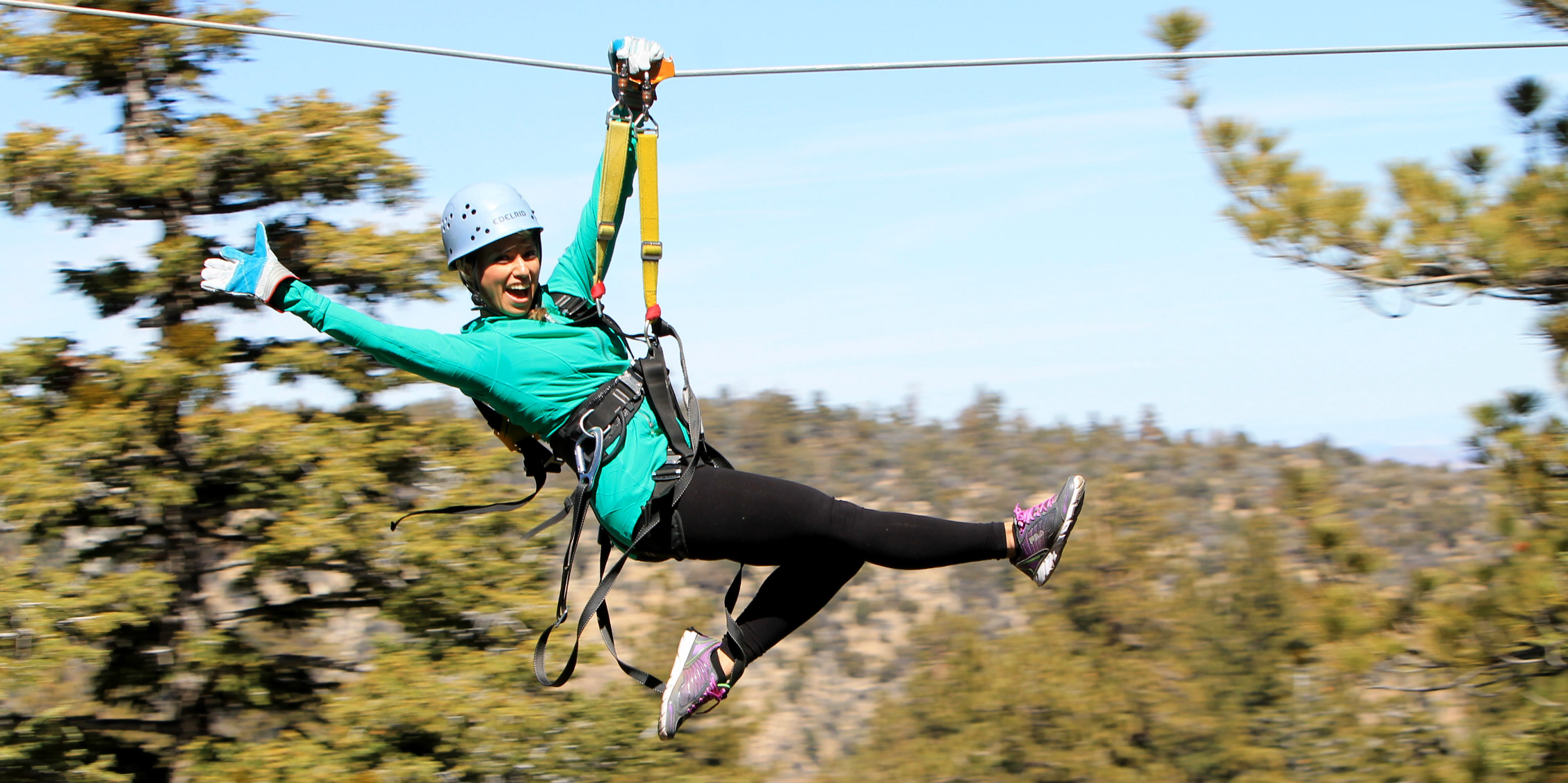 At Big Bear's Action Tours, you can zip on nine separate high-speed zip lines ranging from 140 to 860 feet long and travel through the tree tops up to 85 feet above the forest floor. Each zip is faster and longer than the previous one until you're zipping along at speeds up to 45 mph. Photo courtesy Action Tours.