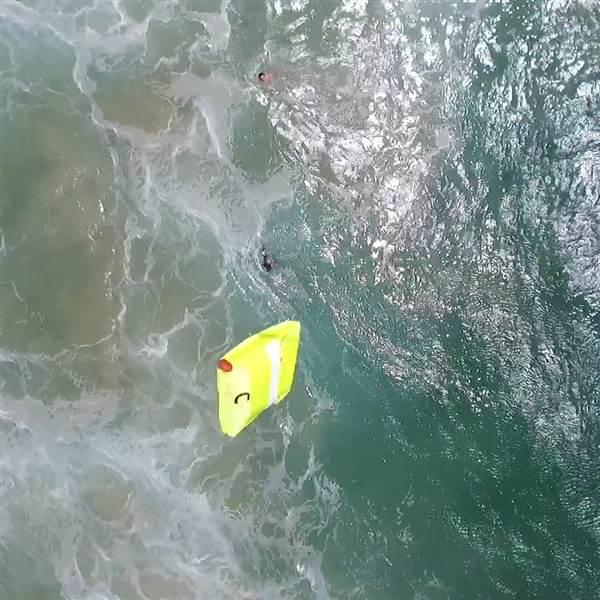 A floatation device falls away from the Westpac Little Ripper to assist two swimmers in distress in Australia on Jan. 18. Photo courtesy of Westpac Little Ripper.