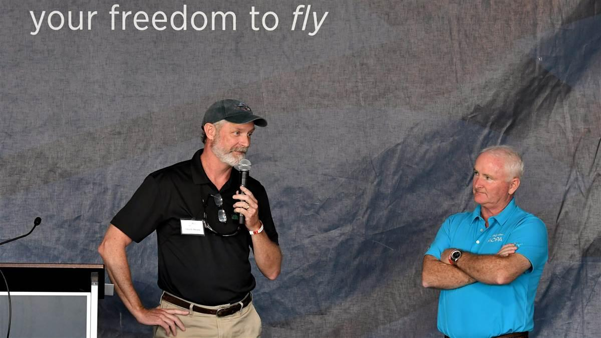 Chuck Ahearn, chairman of the Ray Foundation, left, speaks after AOPA President Mark Baker, right, announced that 3,800 donors contributed more than $1.8 millon to the 2018 You Can Fly Challenge. The Ray Foundation incresed its matching grant from $1.4 million to $1.8 million. Photo by Mike Collins.