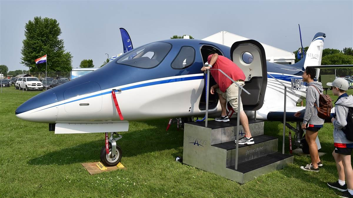 Attendees get a closer look at the Stratos 714 twin jet during EAA AirVenture at Wittman Regional Airport in Oshkosh, Wisconsin, July 23, 2018. Photo by David Tulis.