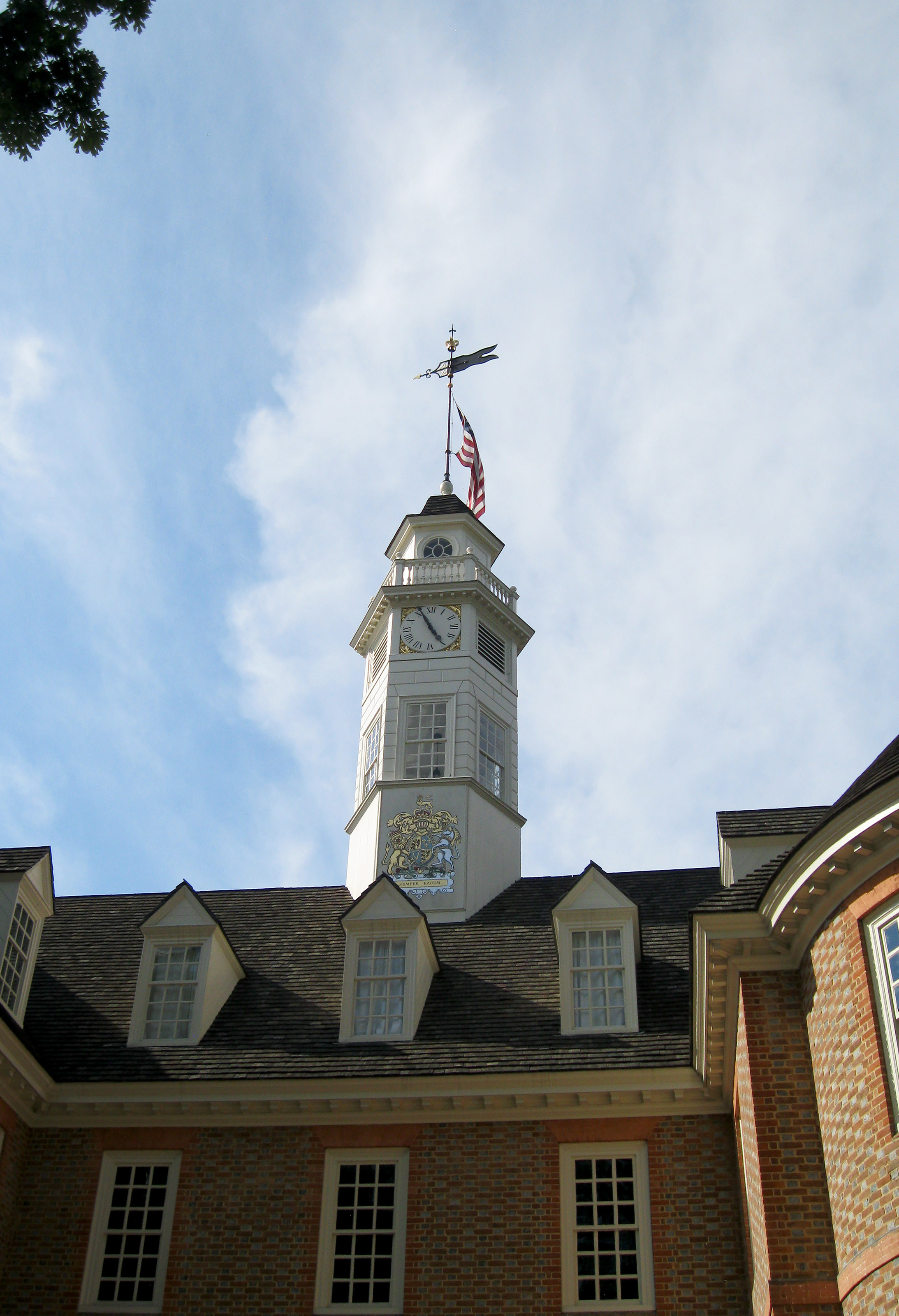 A U.S. flag waves proudly in the breeze above the Capitol in Colonial Williamsburg. The state government occasionally meets in the building to keep it designated as an active Capitol. Groups can tour the building or take part in mock witch trials. Photo by Alyssa Cobb.